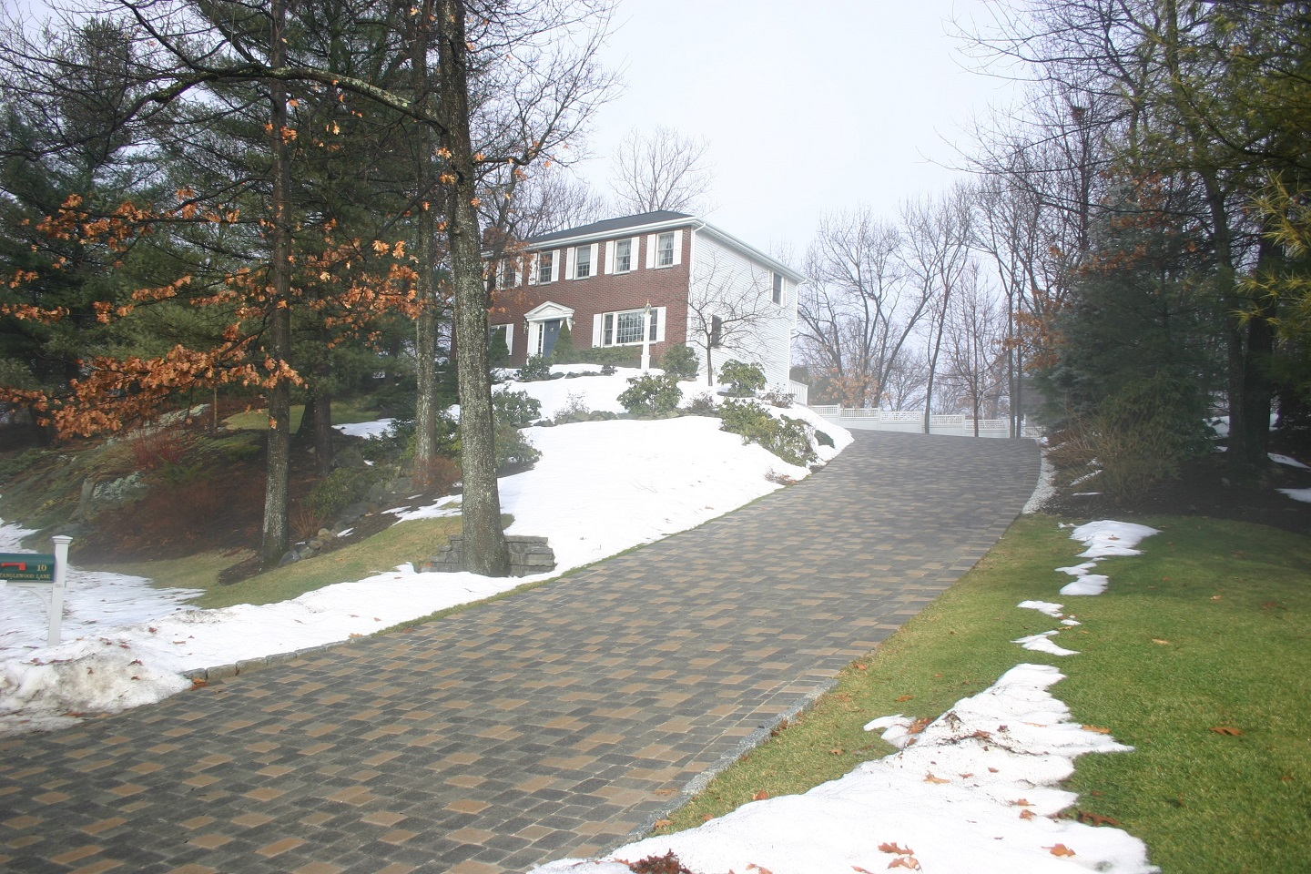 Stunning landscape design with driveway pavers in Brookline, MA