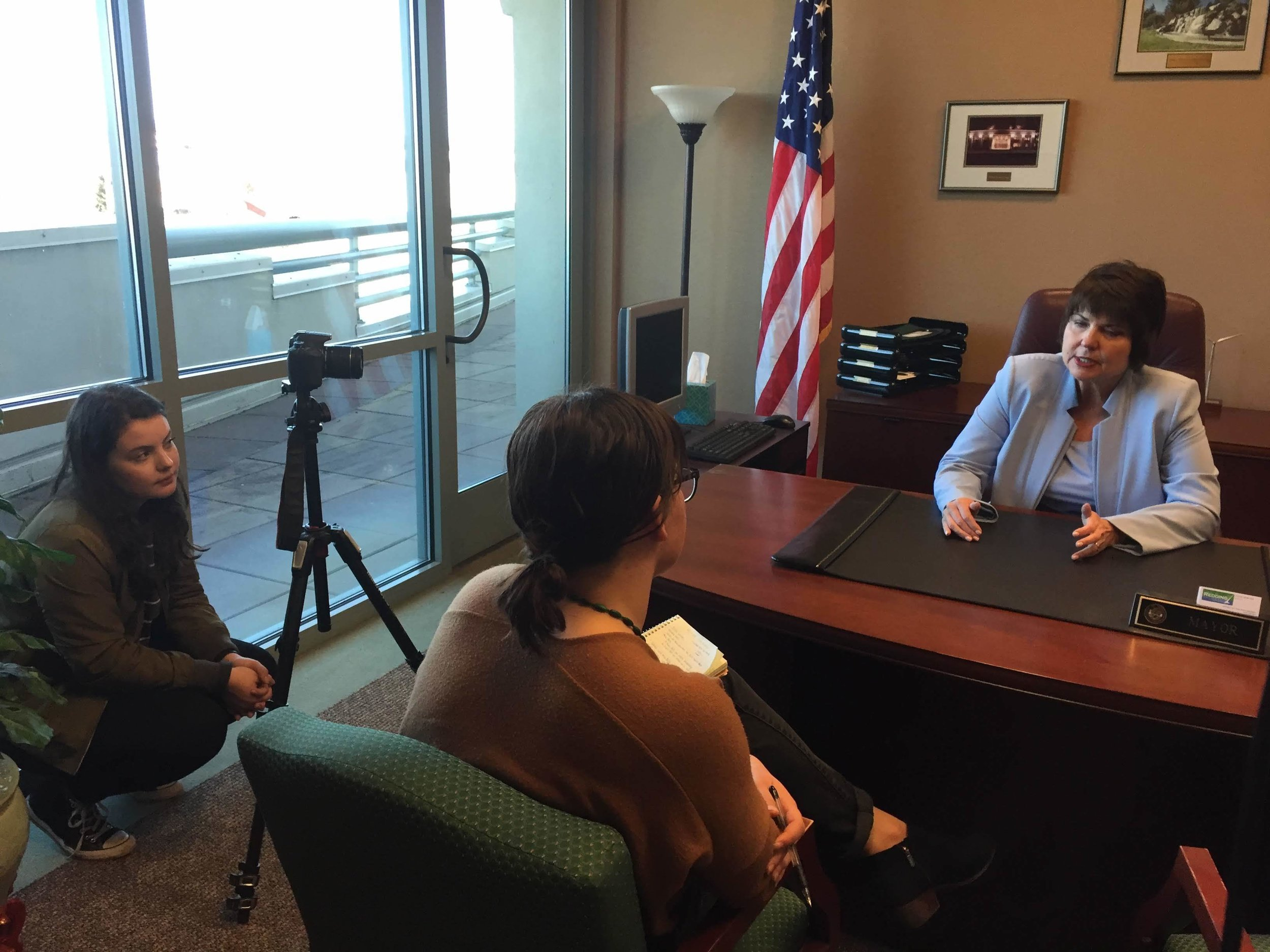 Emily Callahan (left) and Erika Soderstrom (middle) interviewing Julie Winter, Mayor of Redding, California.