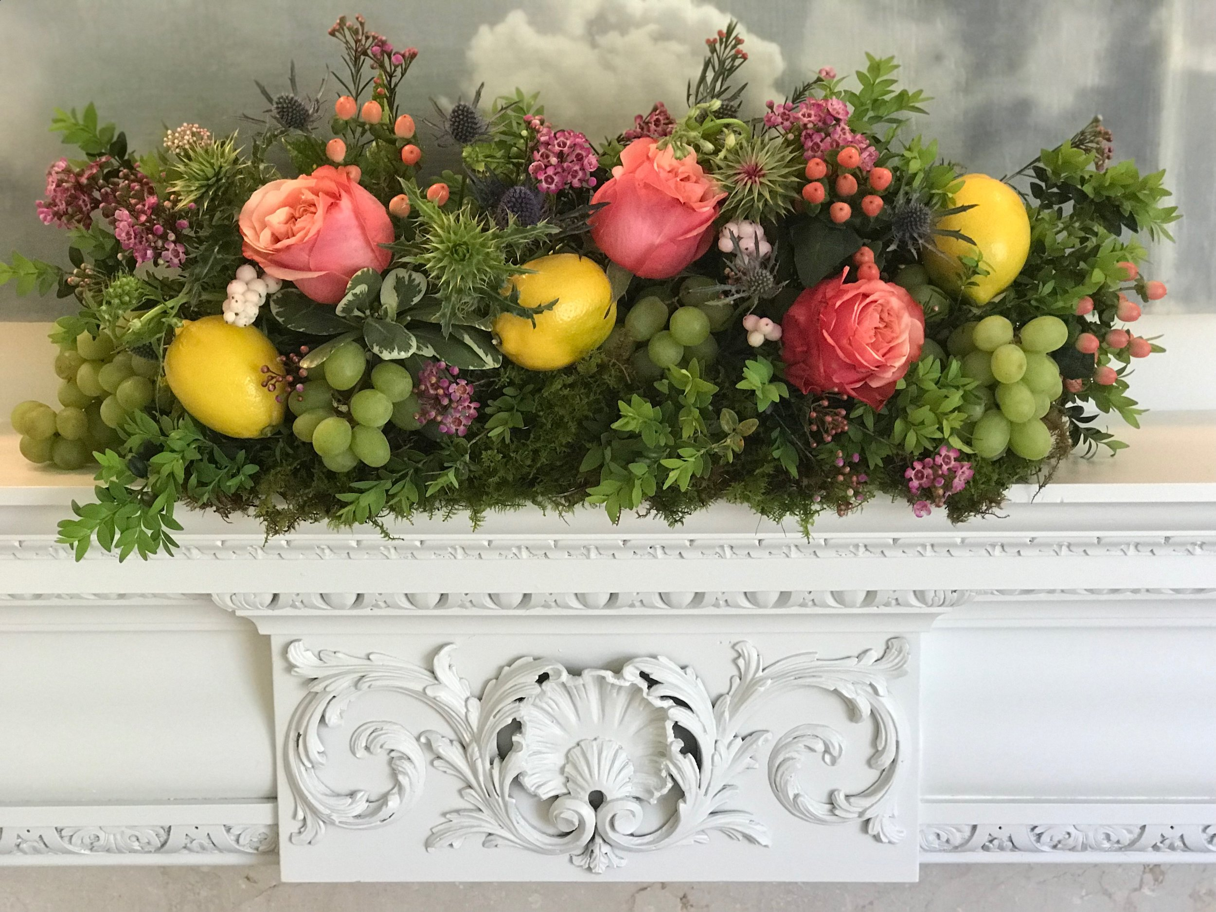 "A ""happy"" mantle with lemons, grapes, and Art Roses at a private home on Lookout Mountain."