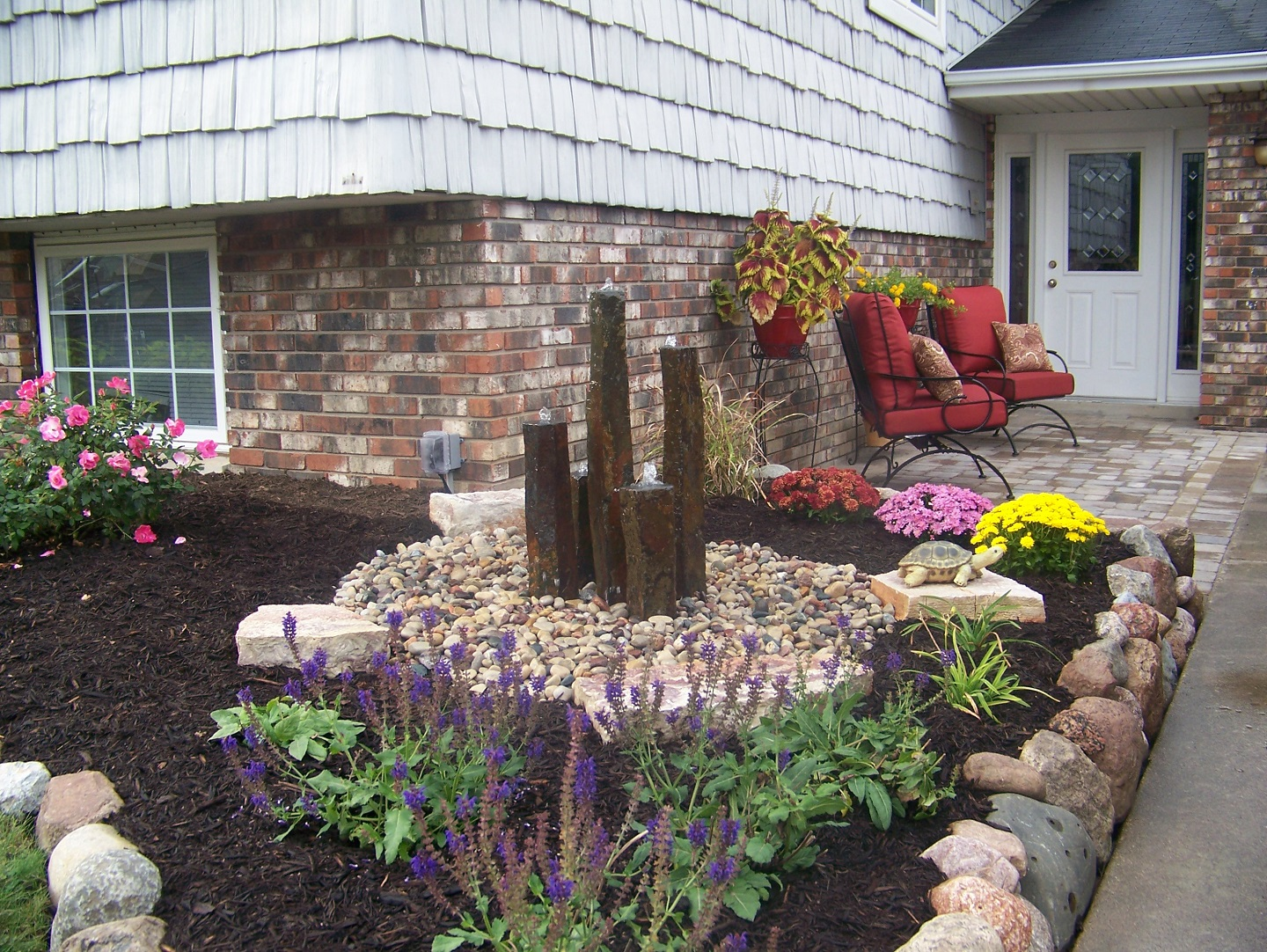 Garden design with water feature in East Peoria, IL