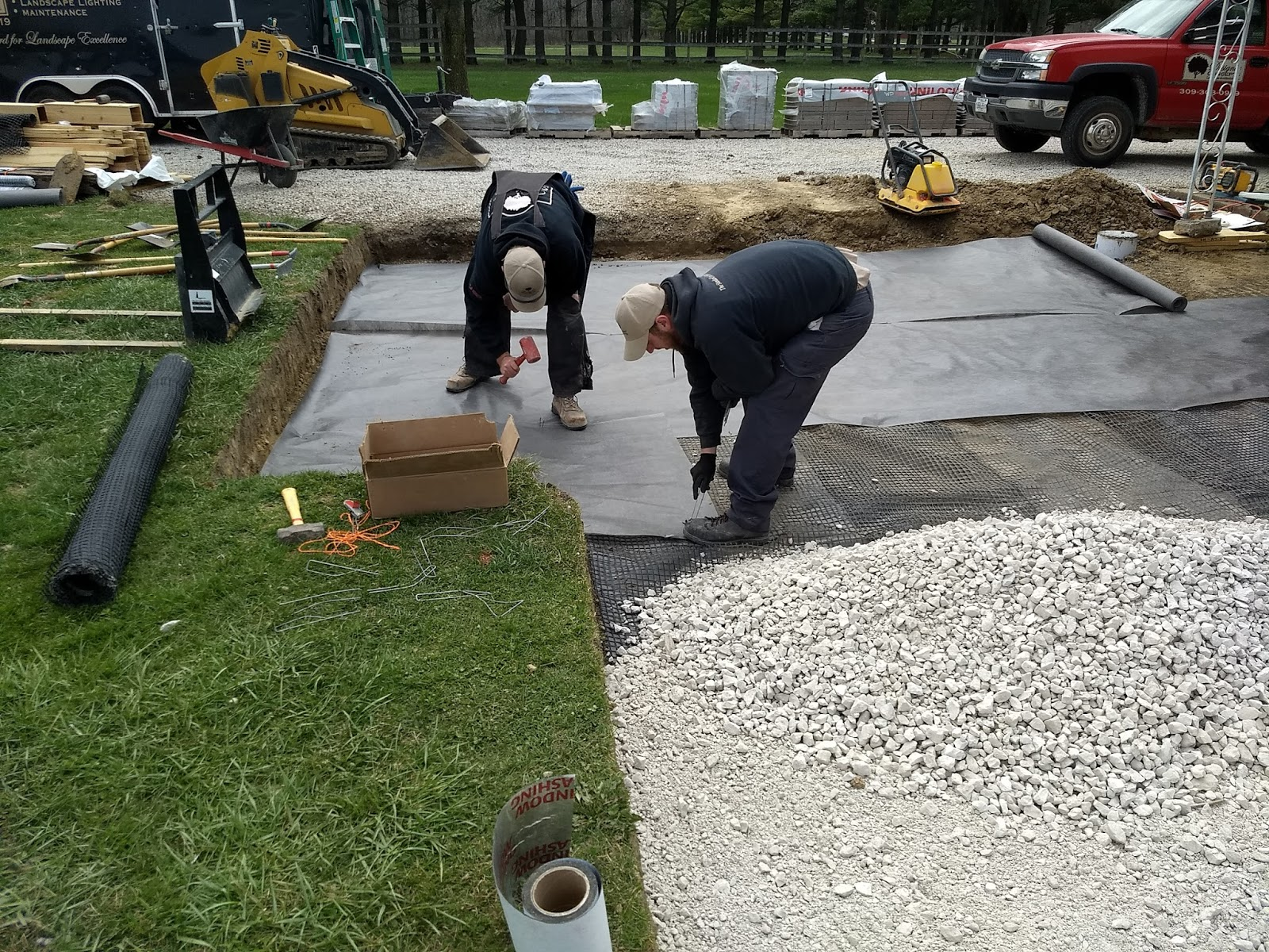 Kevin and Shawn prepare the base for a new paver patio