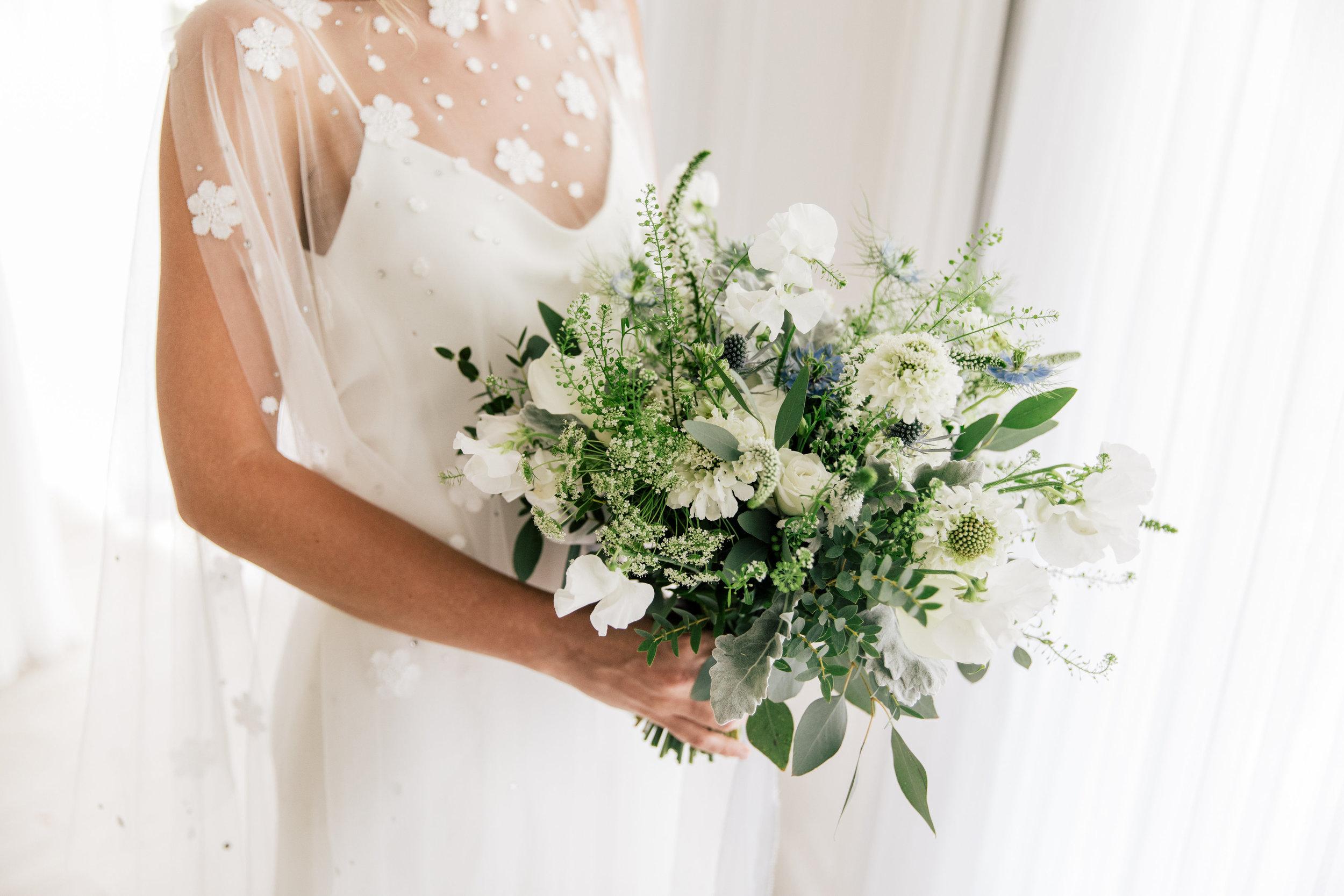 wildflower whit bouquet South Seas Wedding Blue white gray beach destination jet set wed