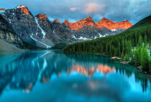 Mountain range reflecting into blue lake
