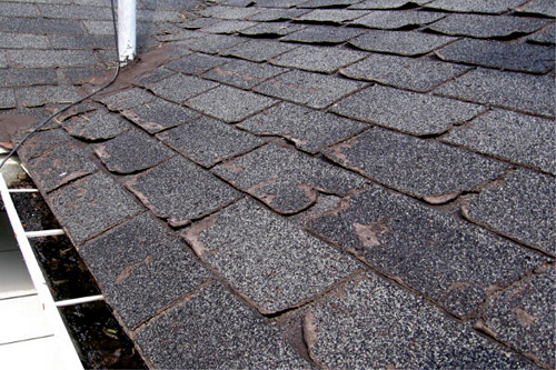 Cracked, worn out shingles missing granules