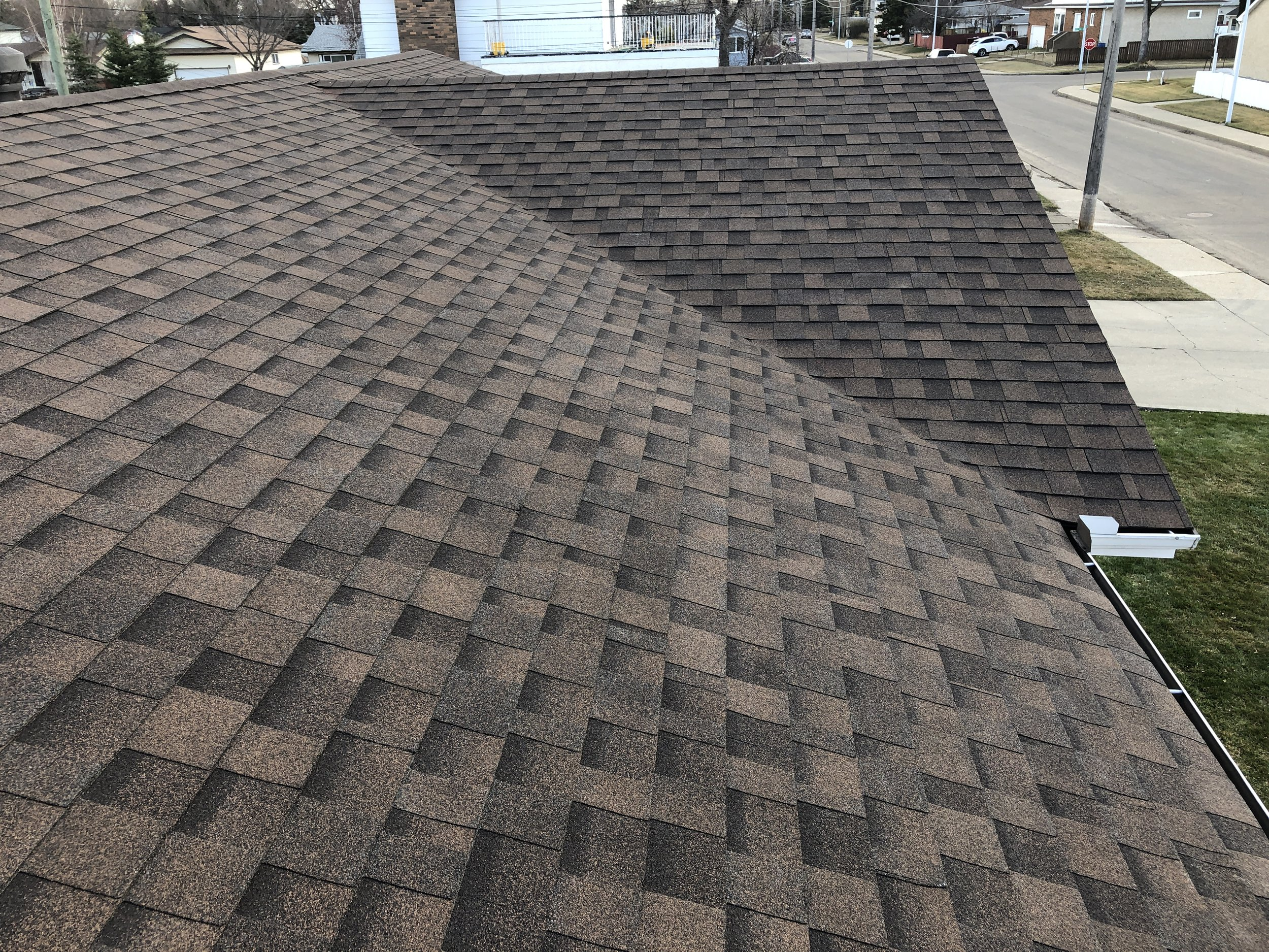 Dual tone brown shingles installed on a residential roof