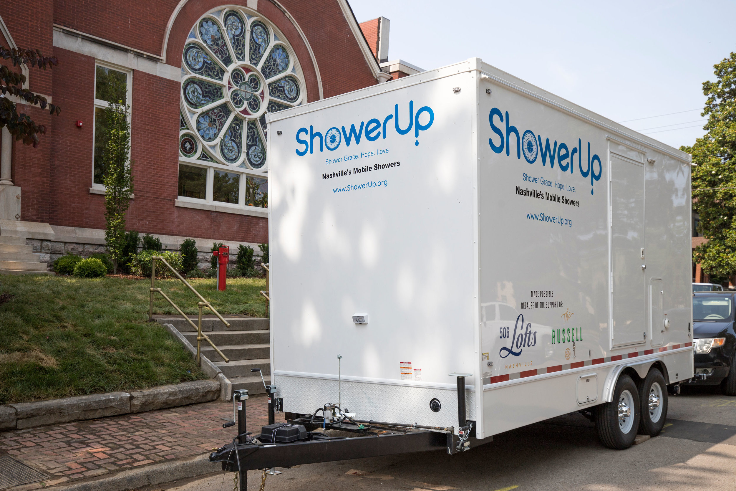 shower up truck donations with russell in background.JPG