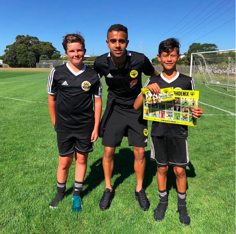 Always a crowd favourite when he returns to visit WPSS. Singh poses with WPSS players in Auckland.