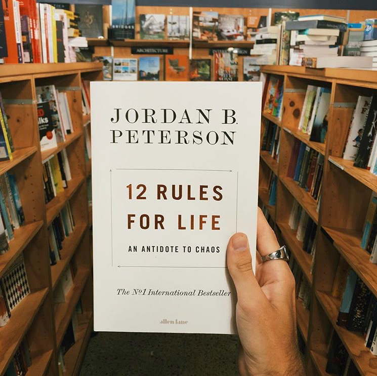 12 Rules for Life: An Antidote to Chaos   Jordan B. Peterson  Acclaimed clinical psychologist Jordan Peterson has influenced the modern understanding of personality and has become one of the world's most popular publicthinkers, lecturing on topics from the Bible to romantic relationships to mythology and drawing tens of millions of viewers. In an era of unprecedented change and polarizing politics, his frank and refreshing message about the value of individual responsibility and ancient wisdom has resonated around the world. In this book, Jordan provides the twelve profound and practical principles on how to live a more meaningful life.  Reviewed by Chris.