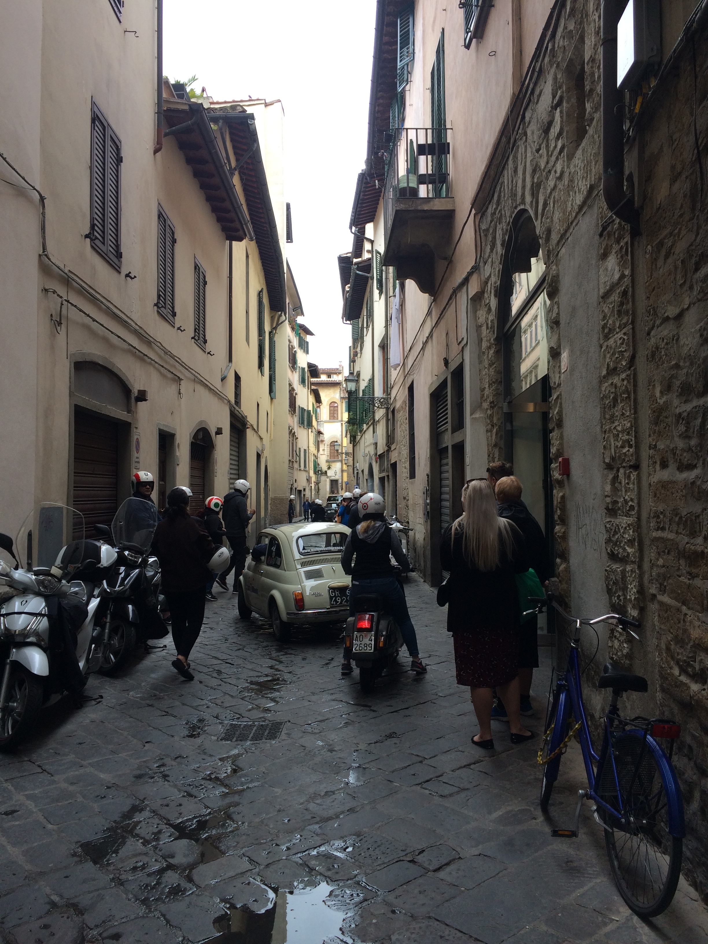 Follow the leader - a classic Fiat Cinquecento leads the way on this Florence Vespa tour for tourists