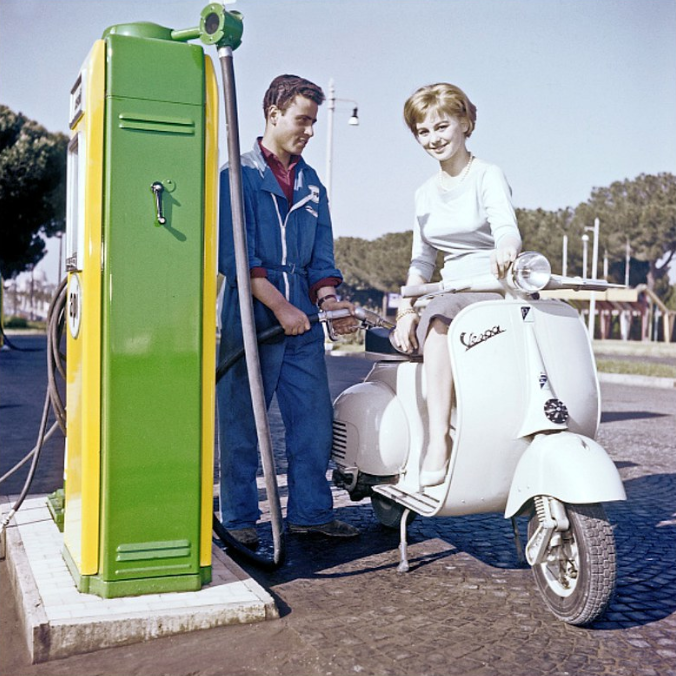 Italian actress Alessandra Panaro on her Vespa at a gas station, photo by Pierluigi Praturlon, Rome, 1957