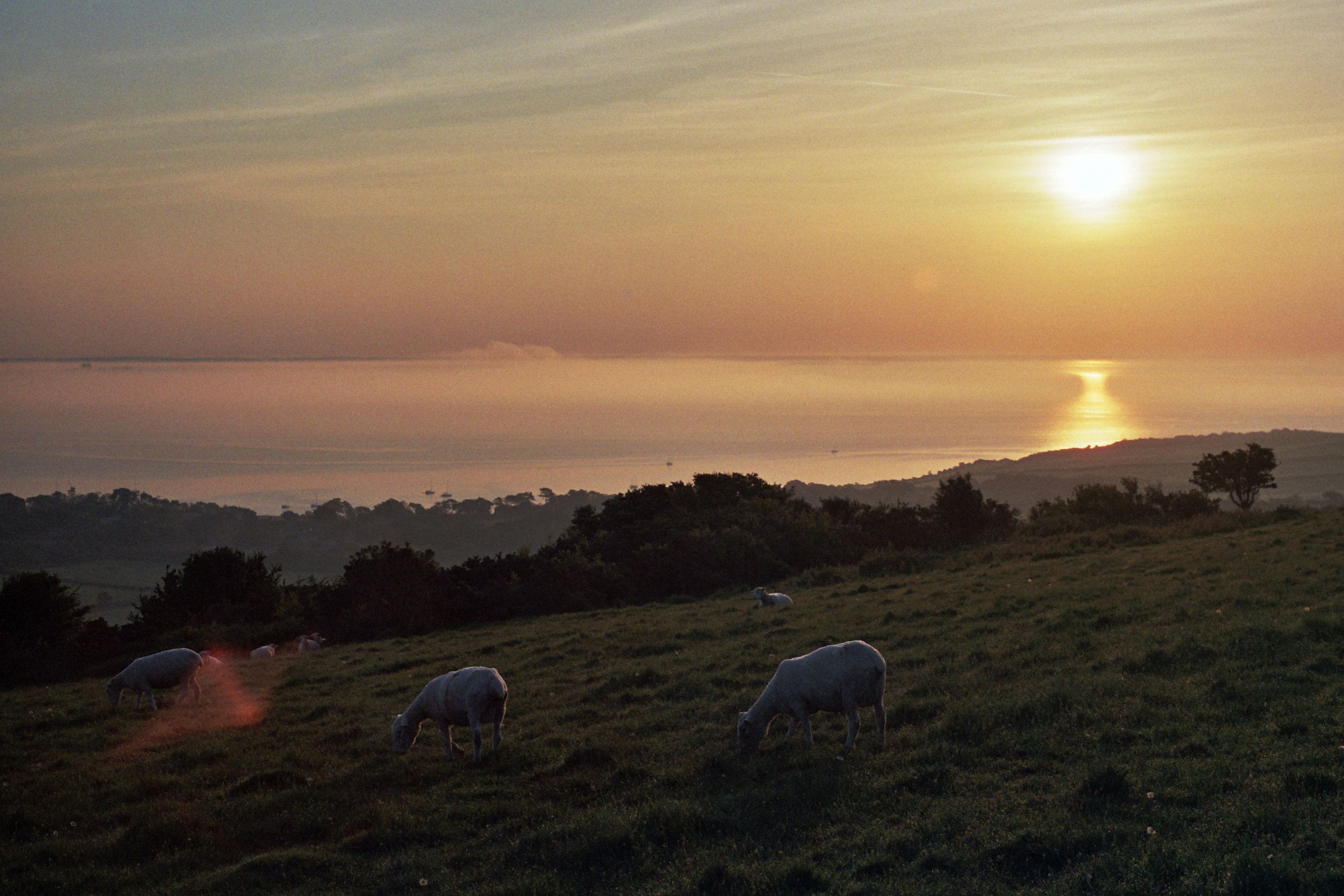 Sunrise walk up the hills and along the cliffs to..