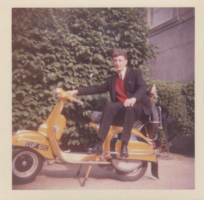 Nigel seated on his Vespa SS180