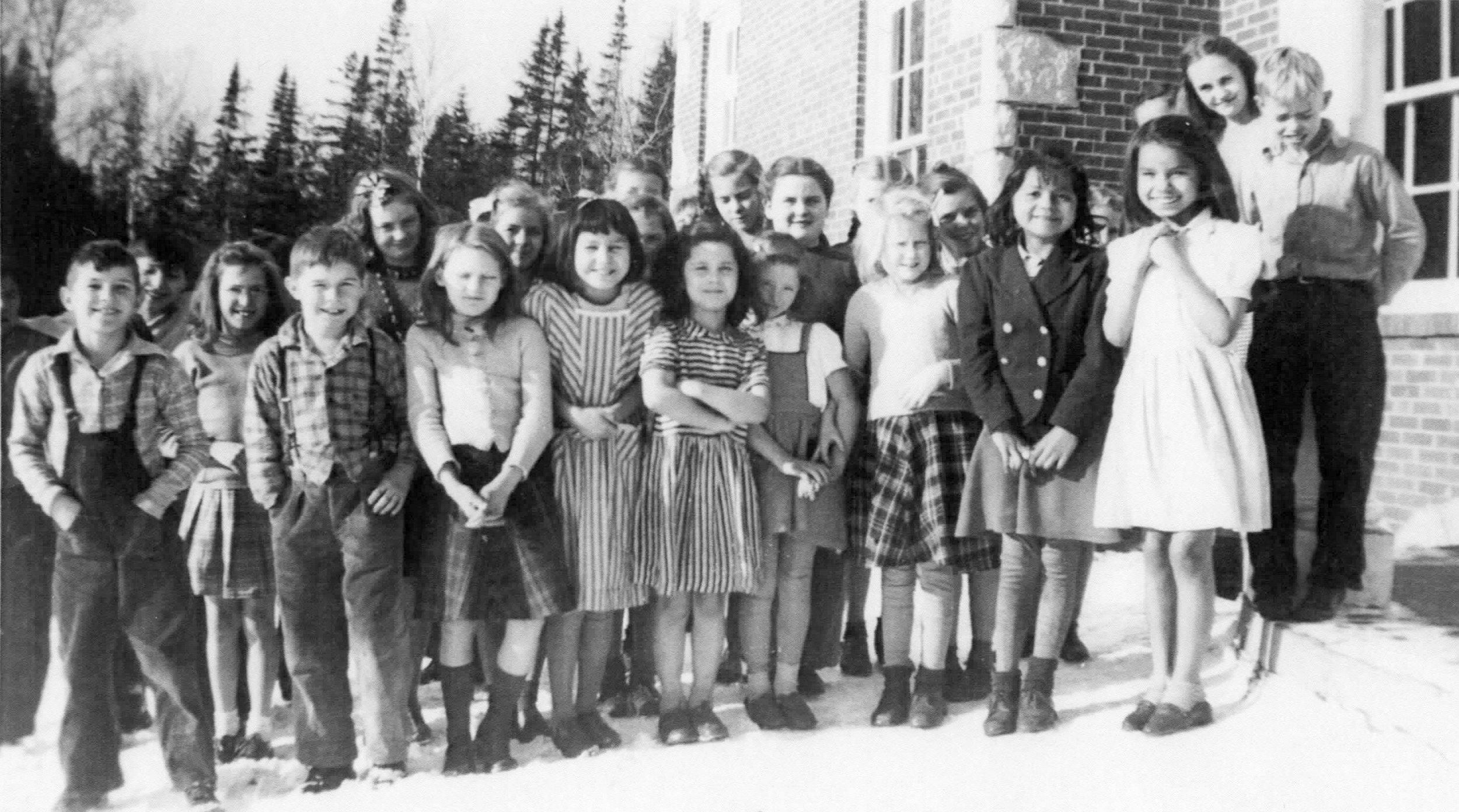 1942 Class Photo - Front Row L-R_____?, John Eseltine, Dorothy Huffman, Ann Causley, Loretta Mongene, Judy McDonald, Ruth Fenlon, Mary Andrews, Margie AndrewsBack Rows L-R_____?, _____?, Jessie Burlew, Helen Lindberg, _____?, _____?, Ireta Lindberg, Dorothy Windsor, Cleo Pope, _____?, _____?, Martina Mertaugh, Billy Walker
