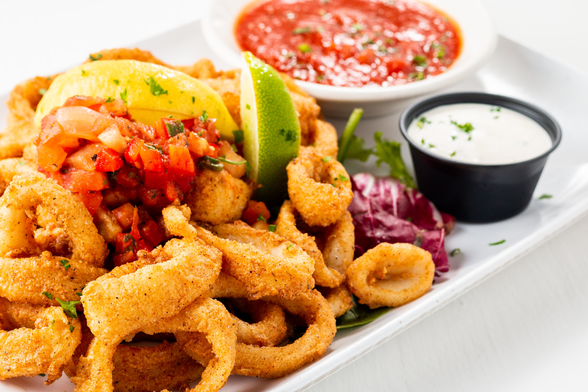 CAJUN LIME CALAMARI - Served crisp, red pepper salsa, cool citrus remoulade