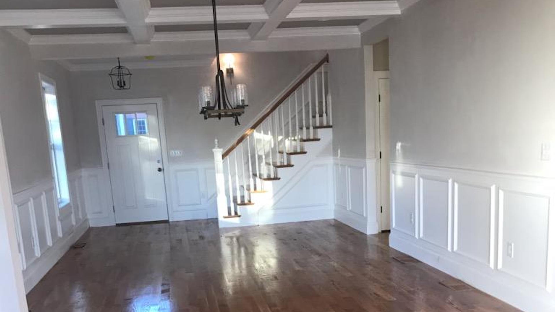 Custom Coffered Ceiling, wall molding, and staircase