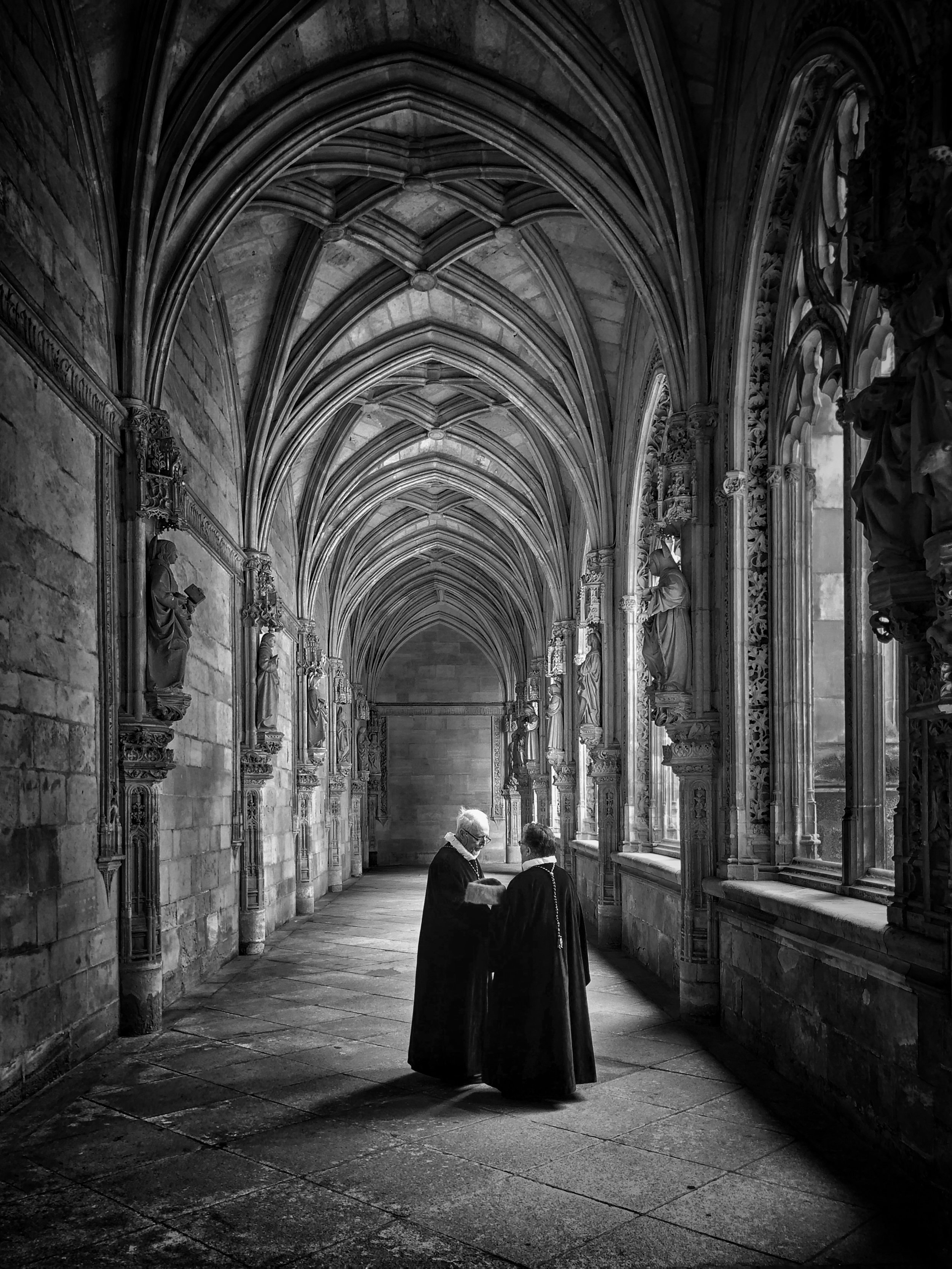Conversation in the cloisters, Toledo, Spain by Joseph Cyr