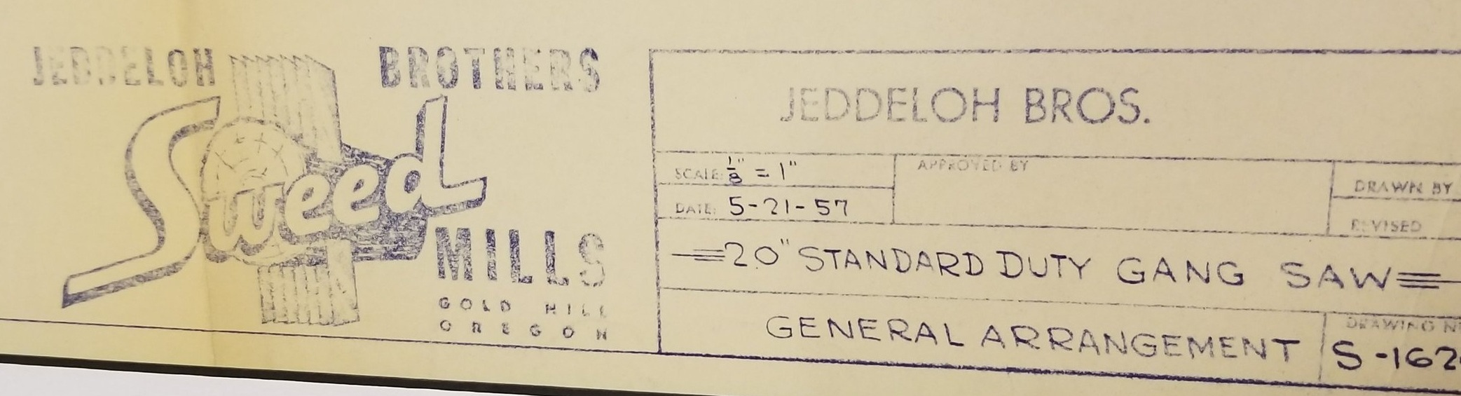 Photo of the original Sweed Mills - Jeddeloh Brothers blueprint from 1957. This blueprint has been preserved and is proudly displayed in the Sweed conference room in Gold Hill, OR, as a reminder of our history.