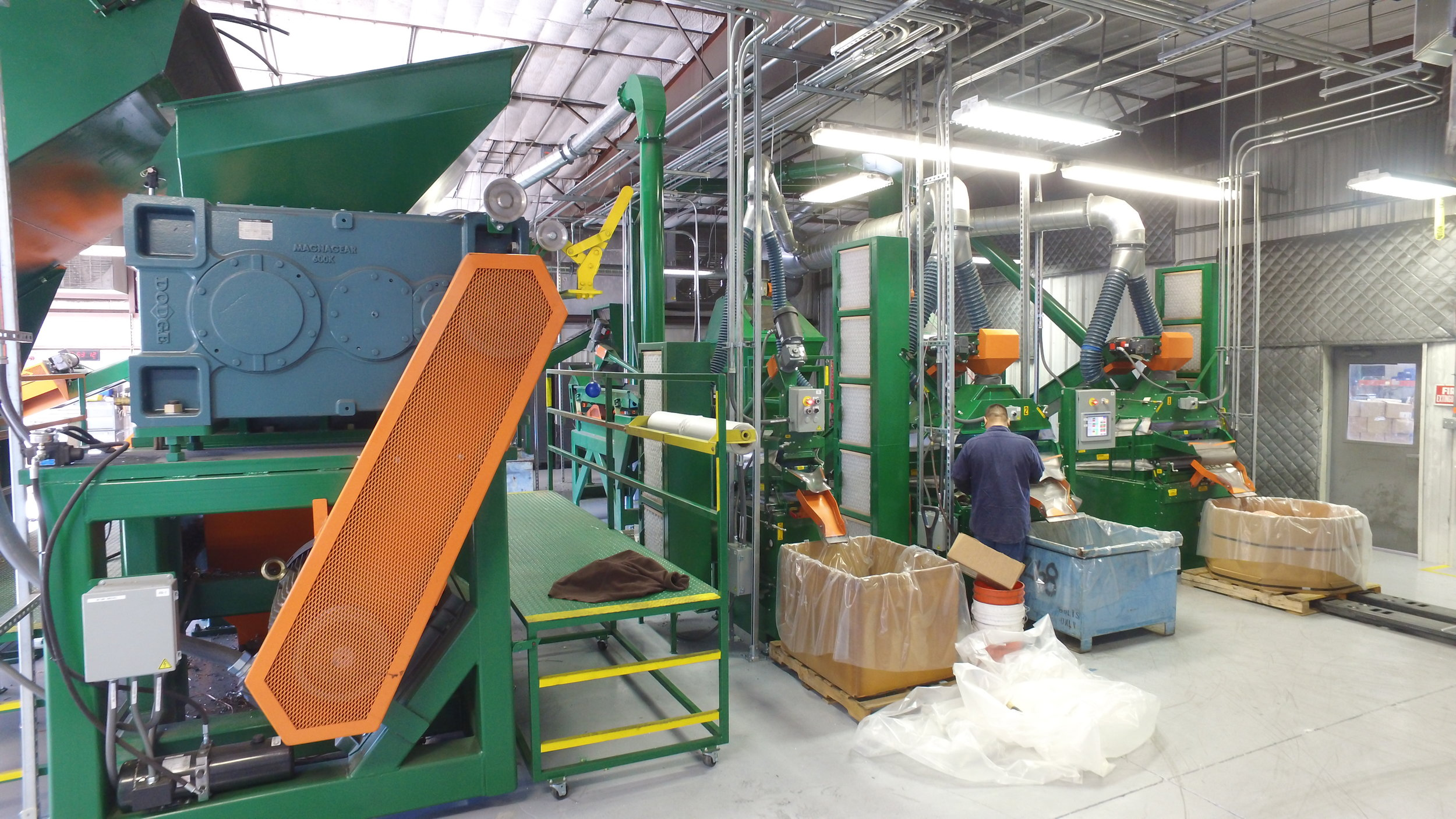 View of the back of SRP's separation system showing side a view of Sweed's Mega Shredder and the copper and aluminum air tables.