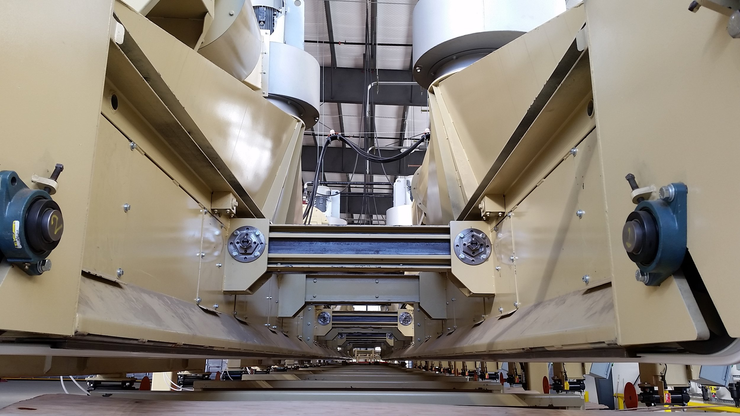 Adjustable plenum on Sweed's Versatile Veneer Stacker - Traditional stackers have a single, fixed air plenum and belts that create negative air suction to lift and hold the sheets for stacking. The 12-bin Sweed Versatile Veneer Stacker incorporates two independent plenums mounted on arbors within a frame, and the plenums can be adjusted to handle any sheet size from 4 ft. 27s up to 10 ft. 54s.
