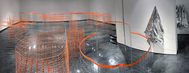 """Naomi J. Falk. Boundings (foreground), Ready or Not (right)   Installation view   60"""" x 288"""" x 480"""" overall   Fencing, marking tape, gaff tape   2018"""