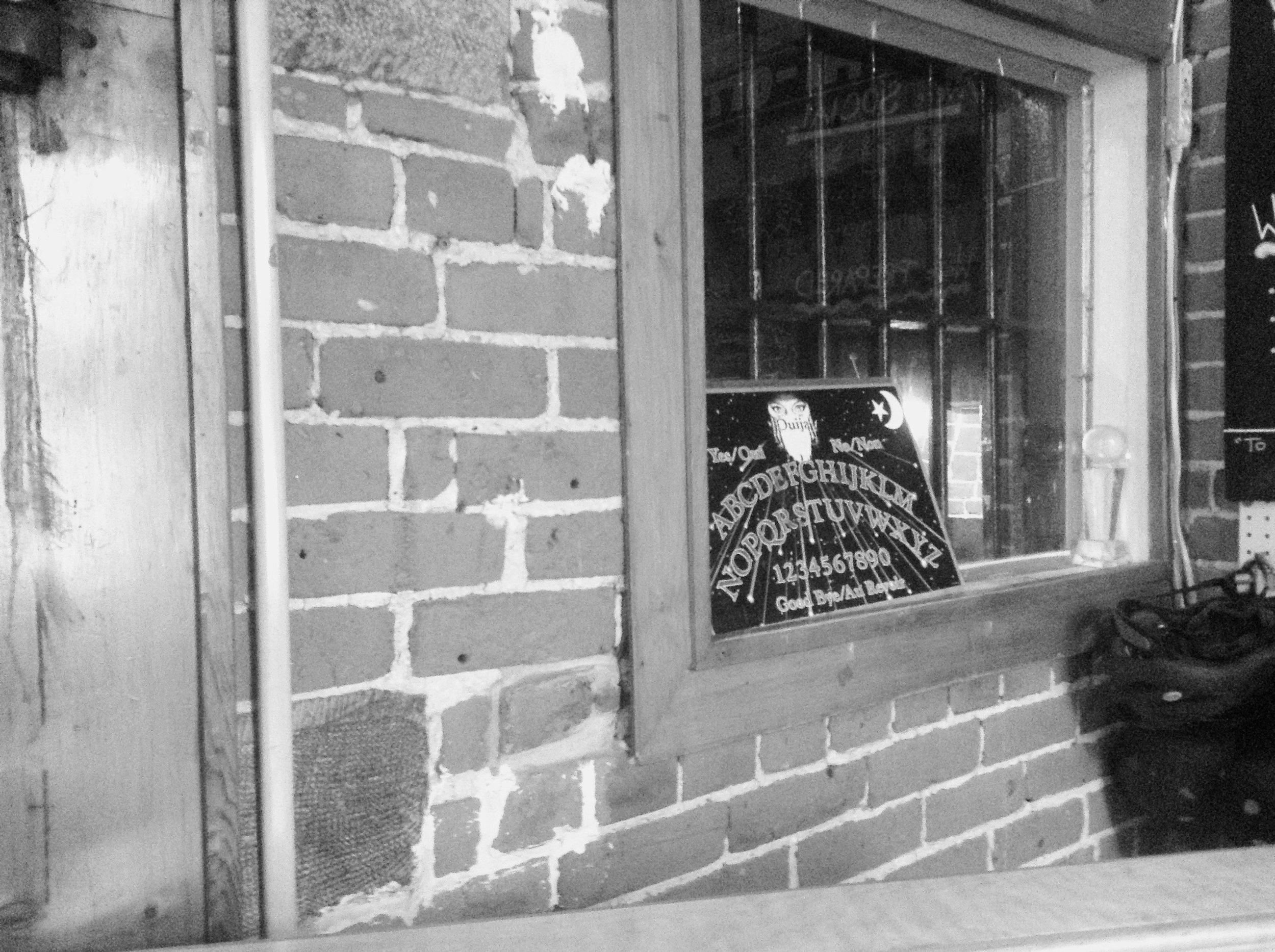 Ouija board in Reception window.