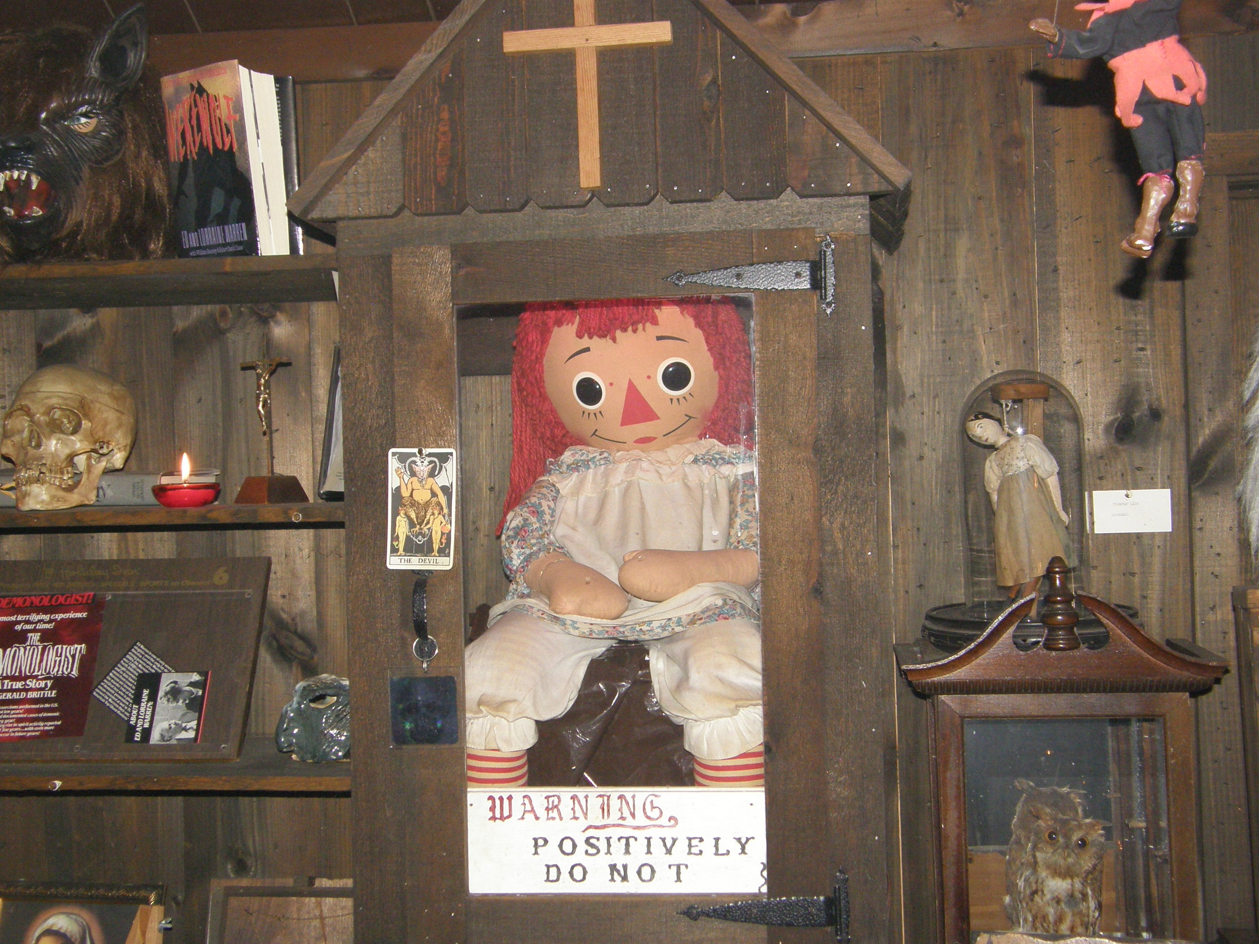 Photo of the real Annabelle doll that currently sits in the Warren's Occult Museum (Photo found via Reddit)