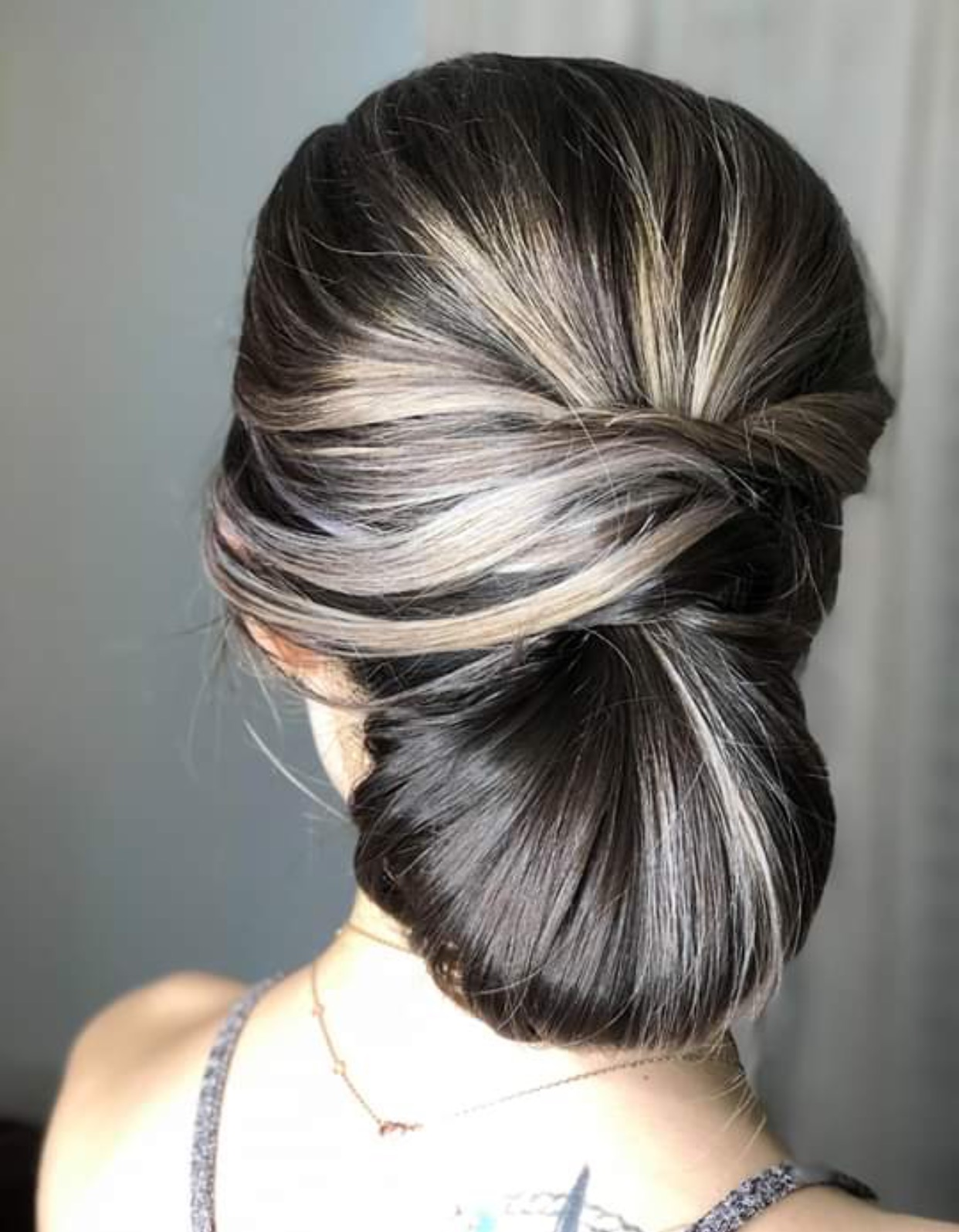 """- 4. THE FRENCH KNOTA CHIGNON IS TYPICALLY A WONDERFUL CHOICE FOR A BRIDE LOOKING FOR A CLASSIC BRIDAL APPEARANCE. THIS """"KNOT"""" AT THE NAPE OF THE NECK CAN BE TAILORED TO YOUR PERSONALITY IN A VARIETY OF WAYS; MODERNIZED WITH A BRAID, OR WITH AN ELEGANT TWIST, OR EVENT JUST SIMPLY STATED, THIS LOOK WILL SURELY REMAIN BEAUTIFUL FOR YEARS TO COME....BRIDE: LAUREN KLEINHAIR STYLIST: EMILY KLEIN SMITH"""