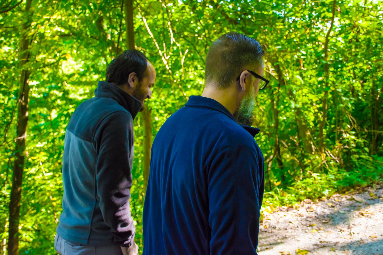 two-men-walking-in-woods-centered-presence-159.jpg