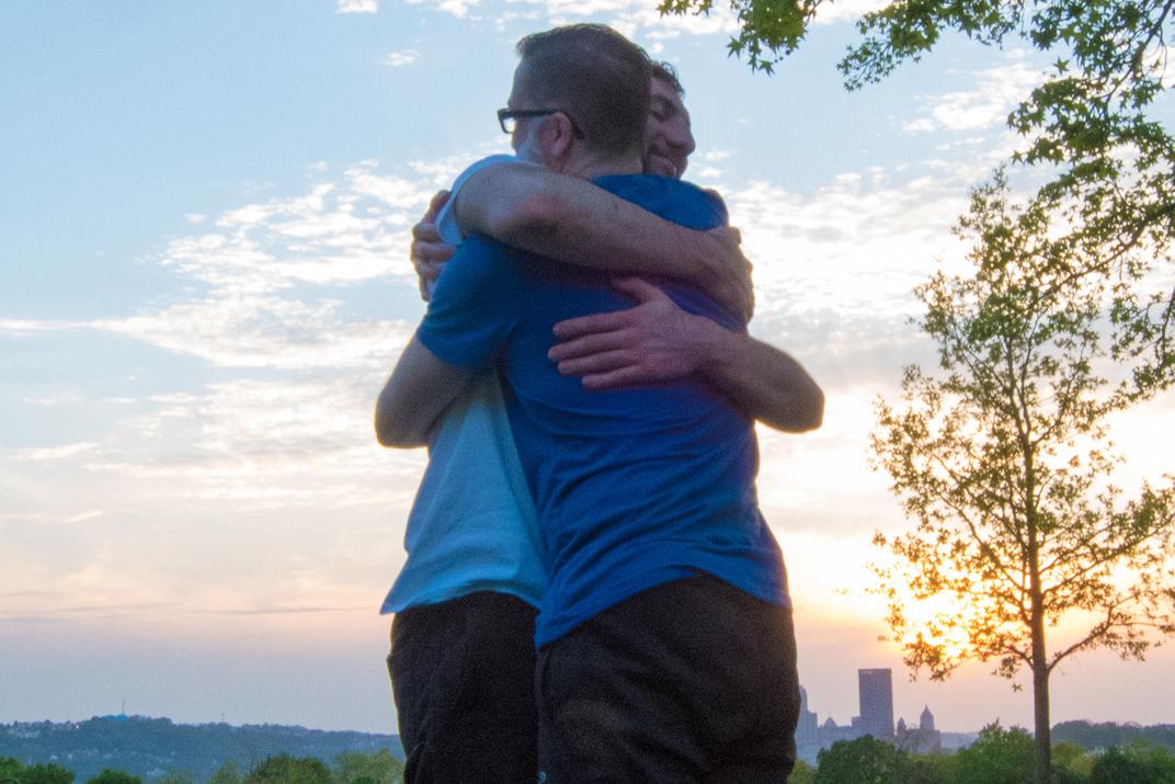 two-men-hugging-touch-practice-centered-presence-yoga-50 B.jpg