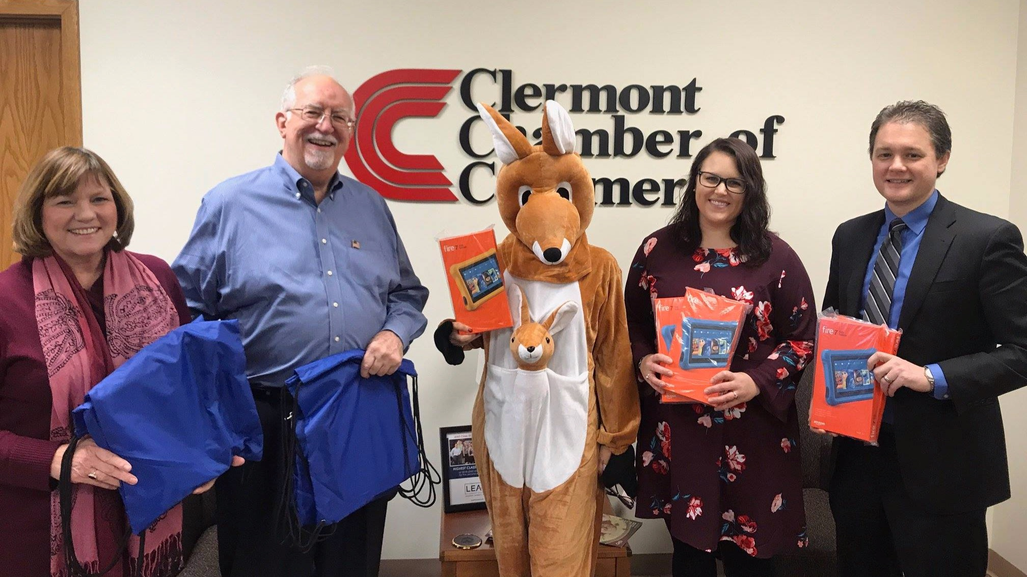 Pictured below are Maria Meinking of YWCA, John Melvin of KLICWOW, Klic LaRoo, Sarah Breedlove of YWCA, and RiverHills Bank President/CEO Brian Dunlap.
