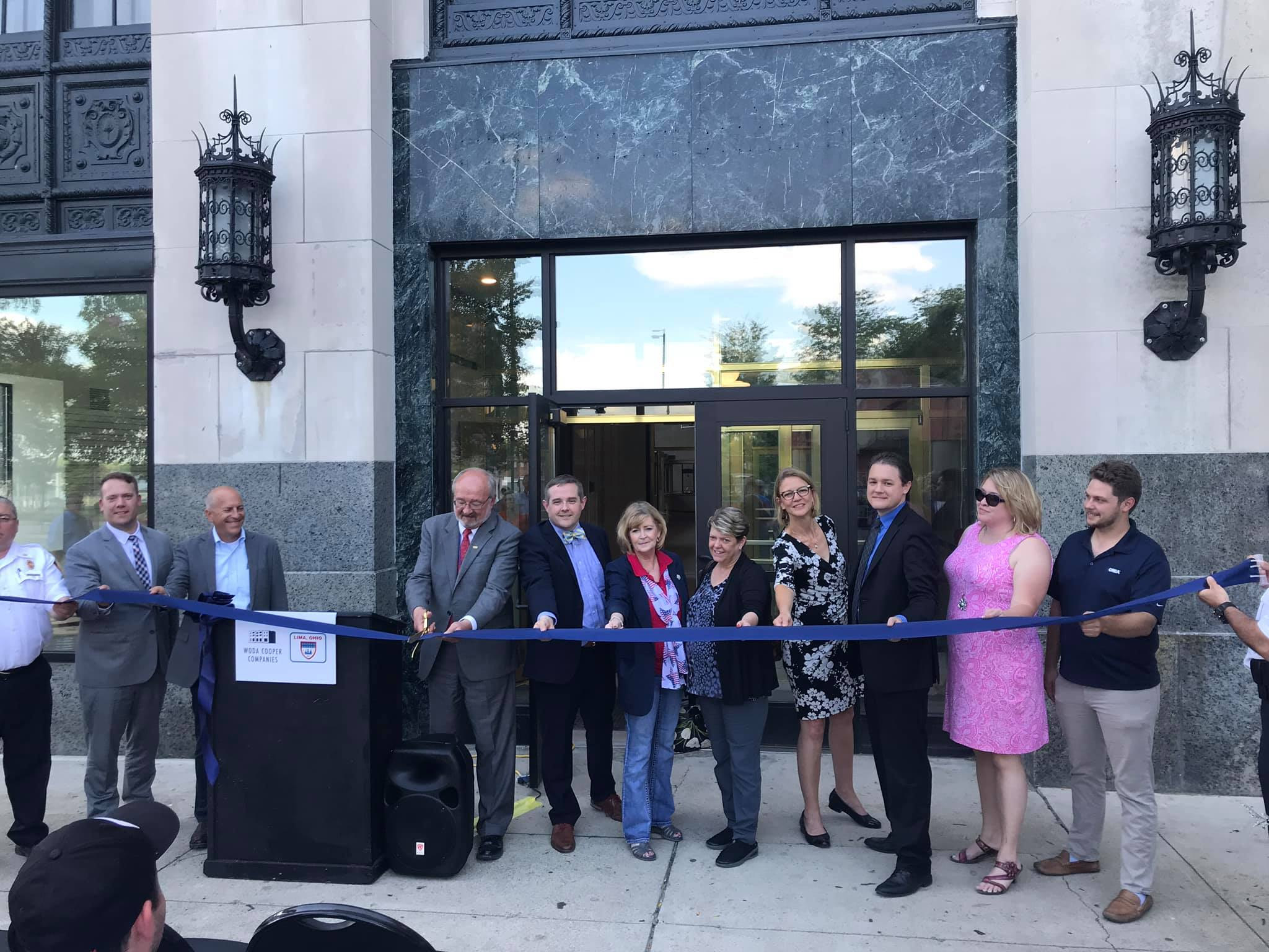 Brian Dunlap, President/CEO attends the ribbon cutting at the grand opening of the newly renovated 43 Town Square