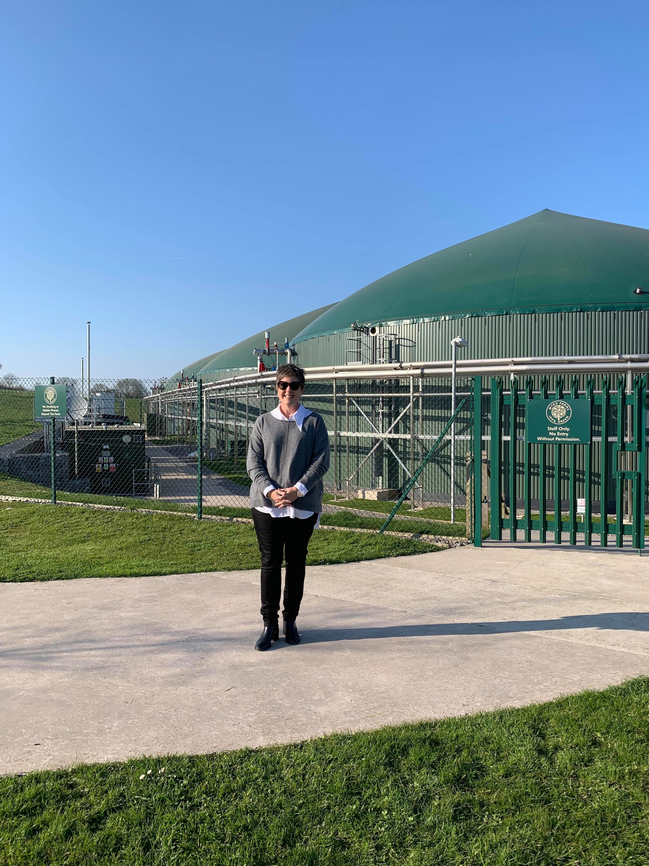 Allison Clark outside Wyke Farms Sustainable Energy Centre in England.