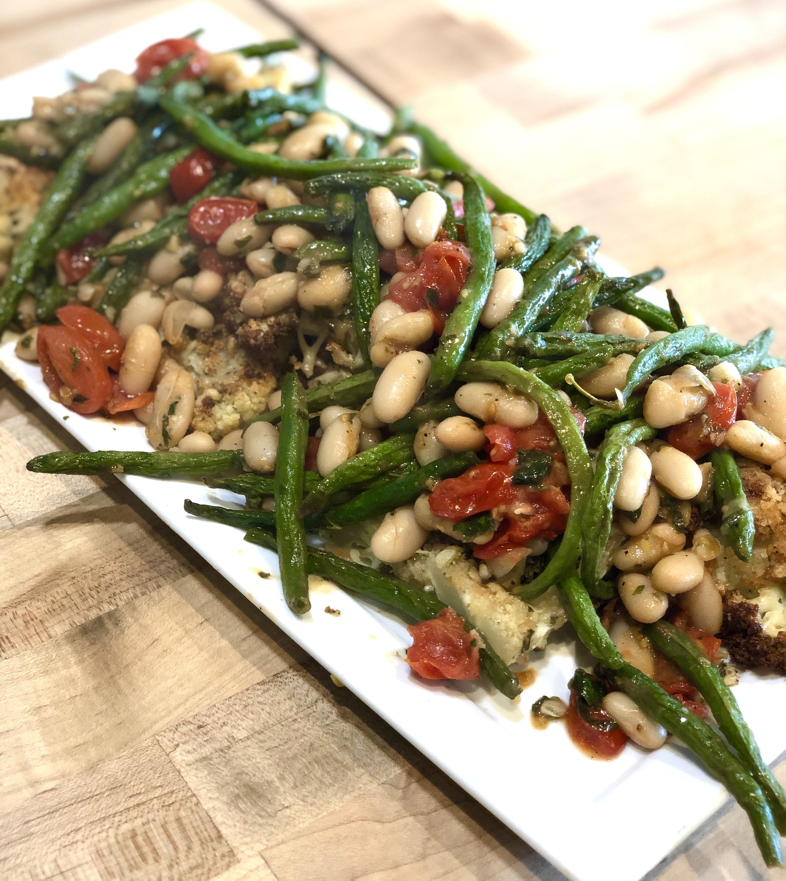 Herb-Crusted Cauliflower Steaks with Beans and Tomatoes