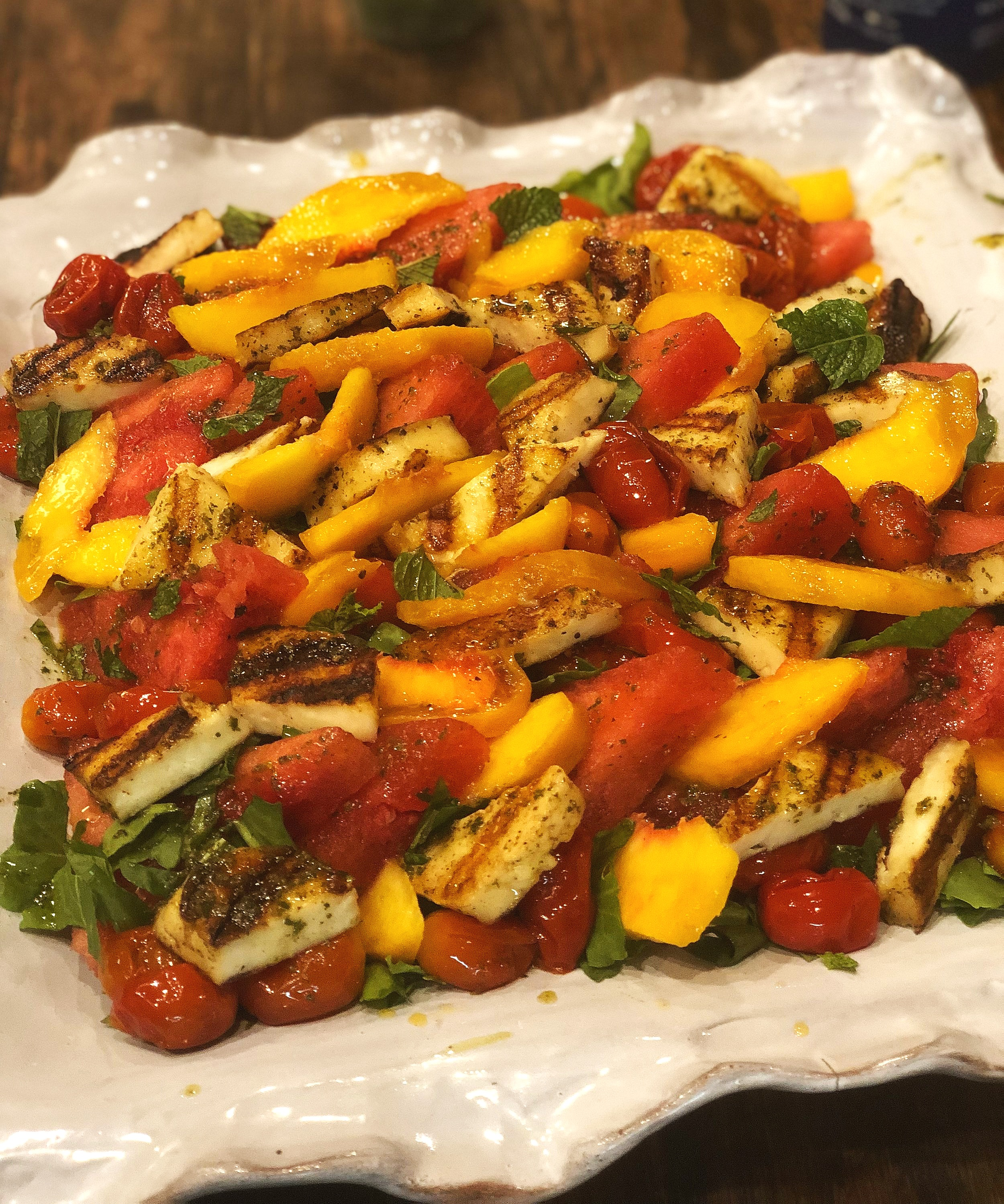 We tucked in some fresh peaches into this salad