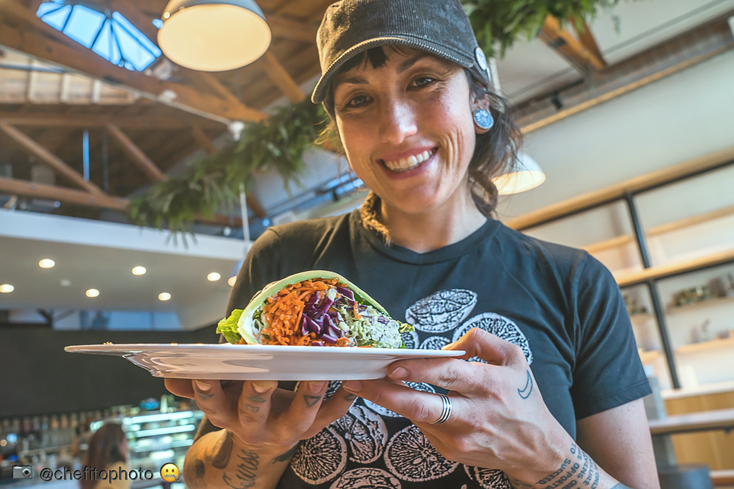 Dawna Bass - Dawna is the chef and co-owner of Under the Sun, Long Beach's first and only raw vegan cafe. She is a self-taught raw food chef who strives to create dishes that can be enjoyed by all.Dawna moved to Long Beach after summer of 2008. In 2011, she met her partner, Chrissy, and shortly after they began their raw food journey with cold-pressed juice. Rainbow Juices opened in Downtown Long Beach in 2014, and Under the Sun opened next-door in 2017.For Dawna, raw vegan cuisine is synonymous with how she wants to live her life: thoughtful, compassionate, growing and flowing with the seasons, ever-changing, unpredictable, and full of life and positivity. She serve food that satisfies the palate, that you feel good about eating, and that contributes to your overall well-being.