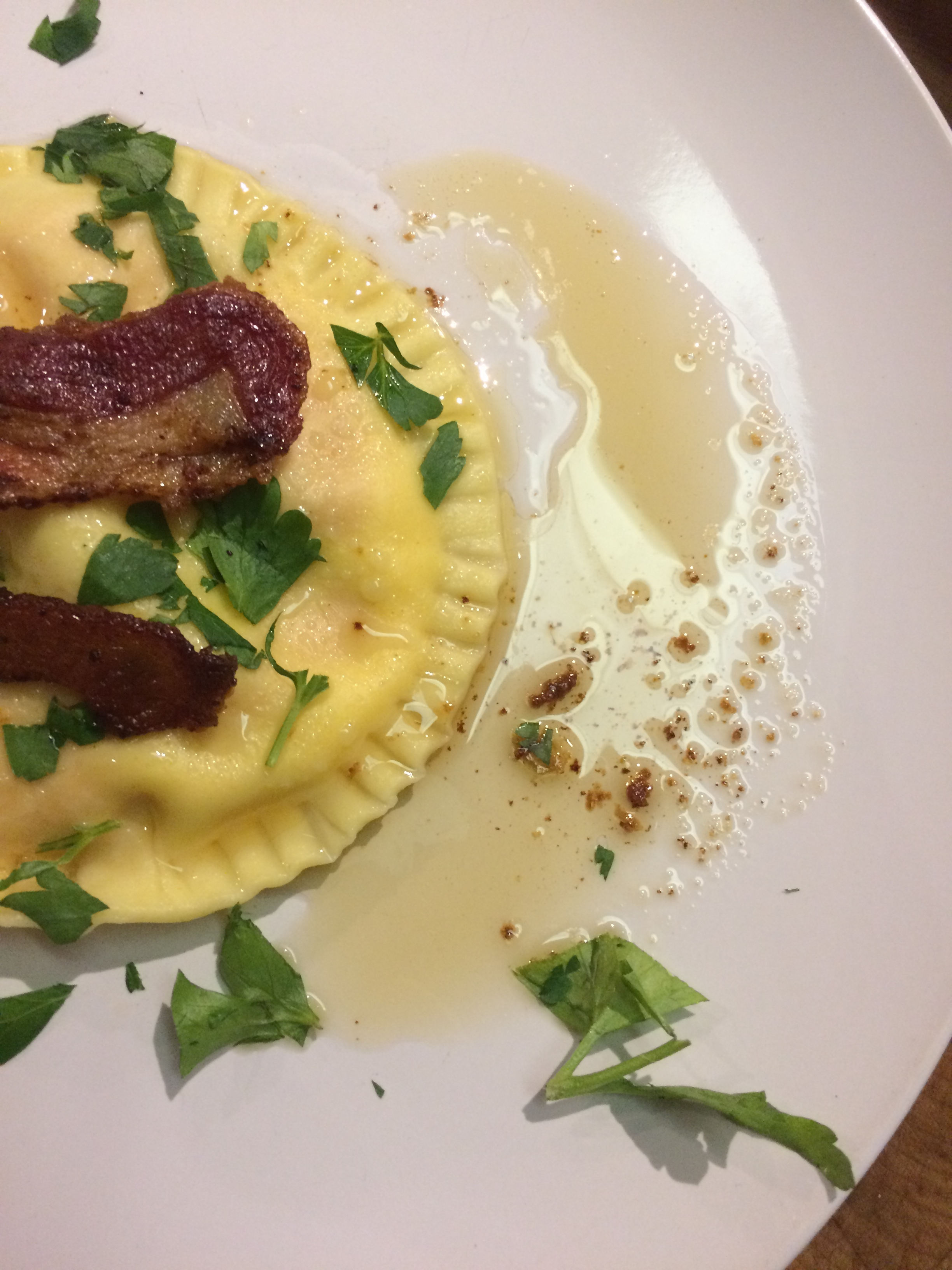 Sweet Potato Goat Cheese Raviolo topped with guanciale