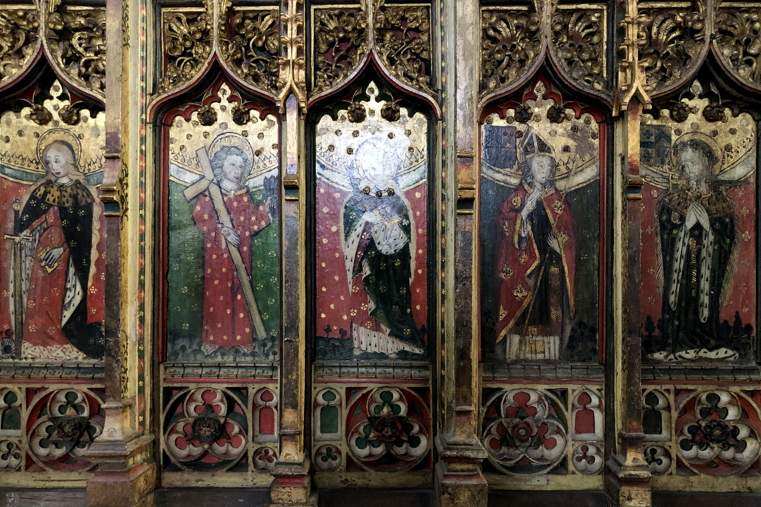 St Peter and St Paul, Eye. The figures on the dado screen, painted around 1500.