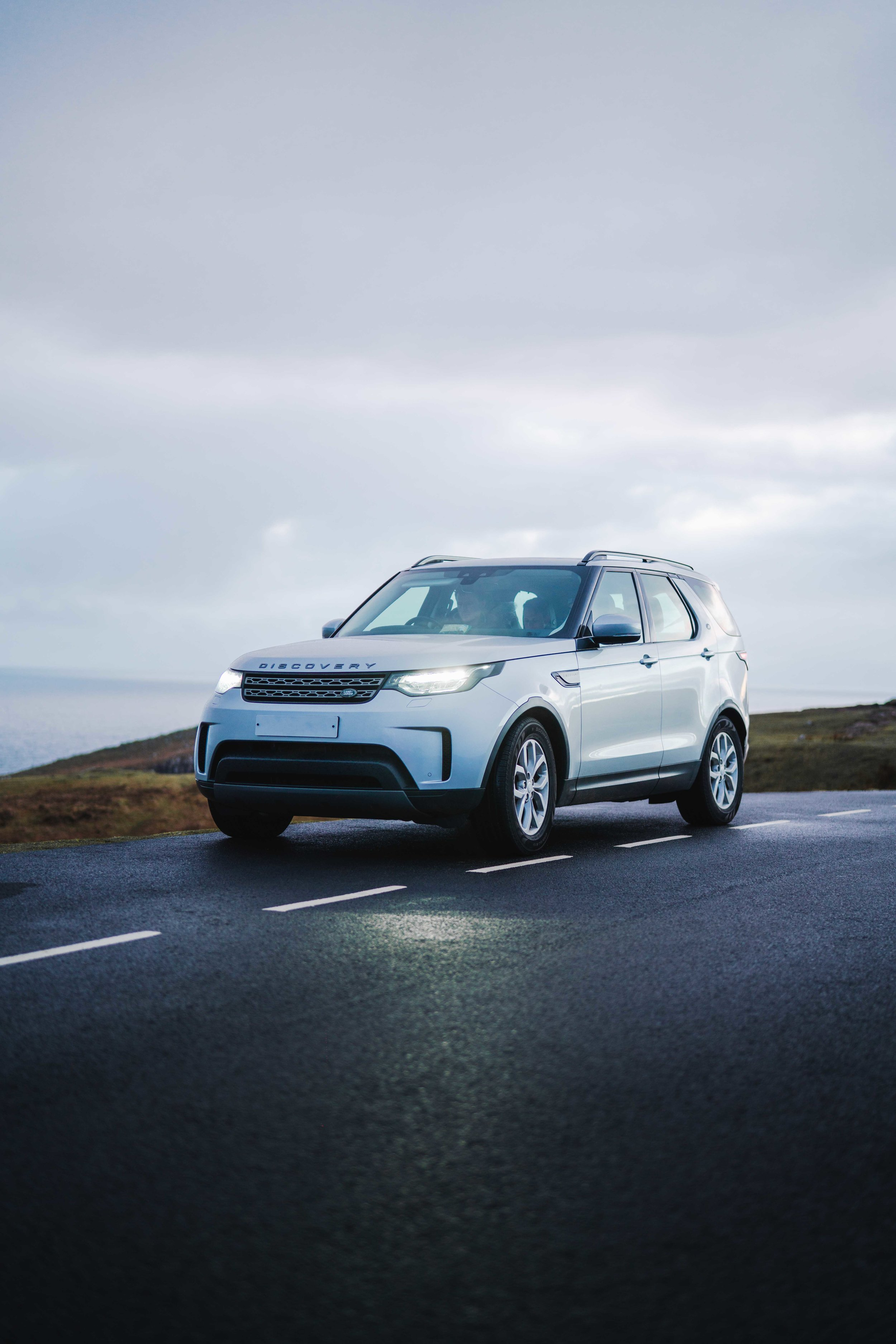 Land Rover Discovery in Scotland on the road.