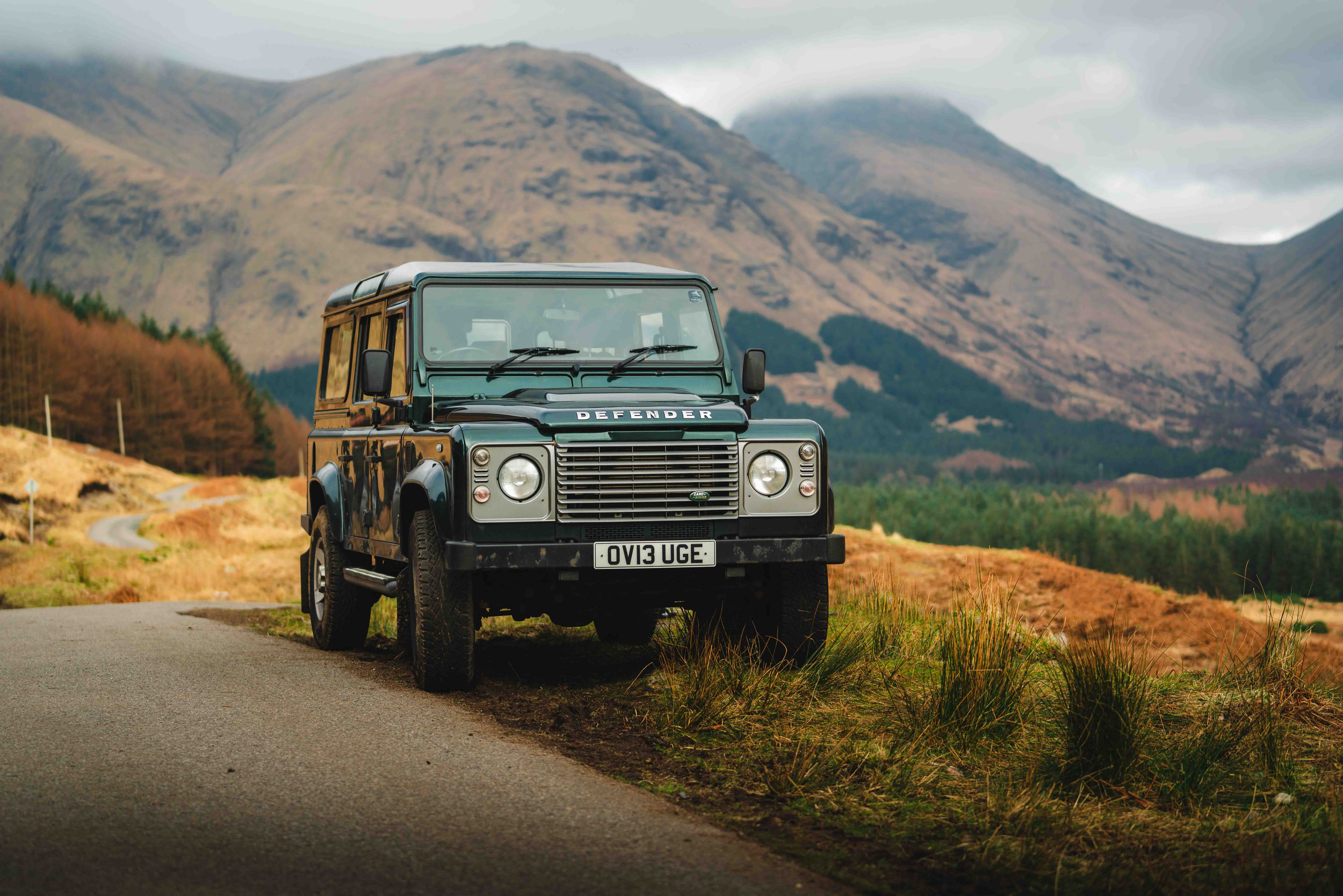 Land Rover Discovery in Scotland by sunset.