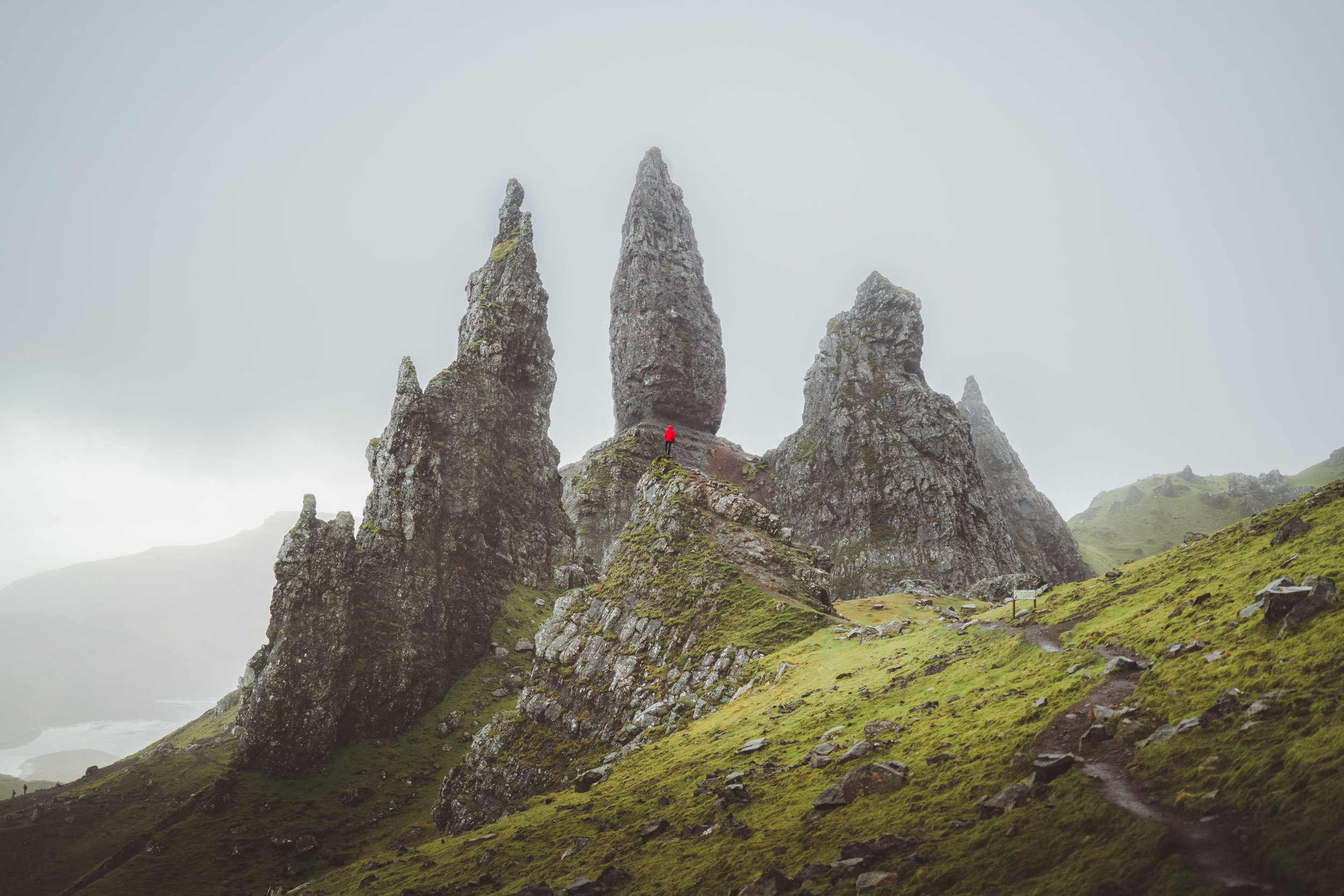 Man with red jacket in the rock of Old Man of Storr