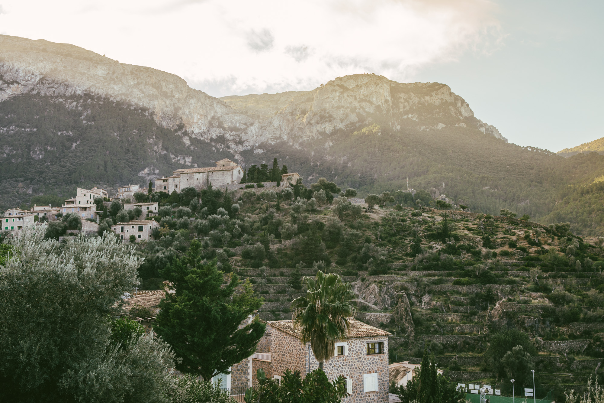 A view of part of Deiá as the sunlight begins to spill over the mountains.