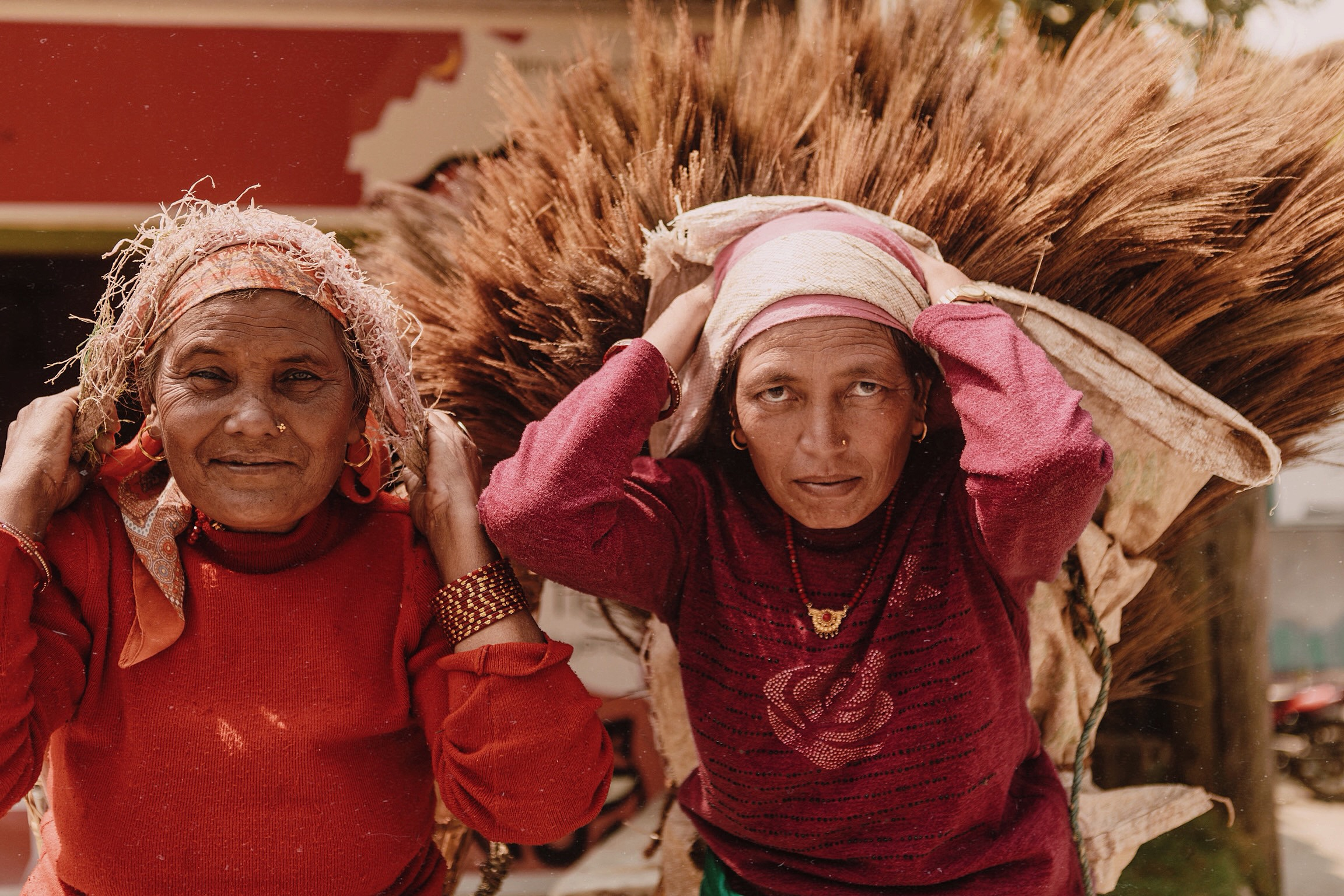 - Two women on the streets of Pokhara, Nepal transport heavy materials by wrapping baskets and bags around their heads and using the strength of their necks and backs to support the weight.