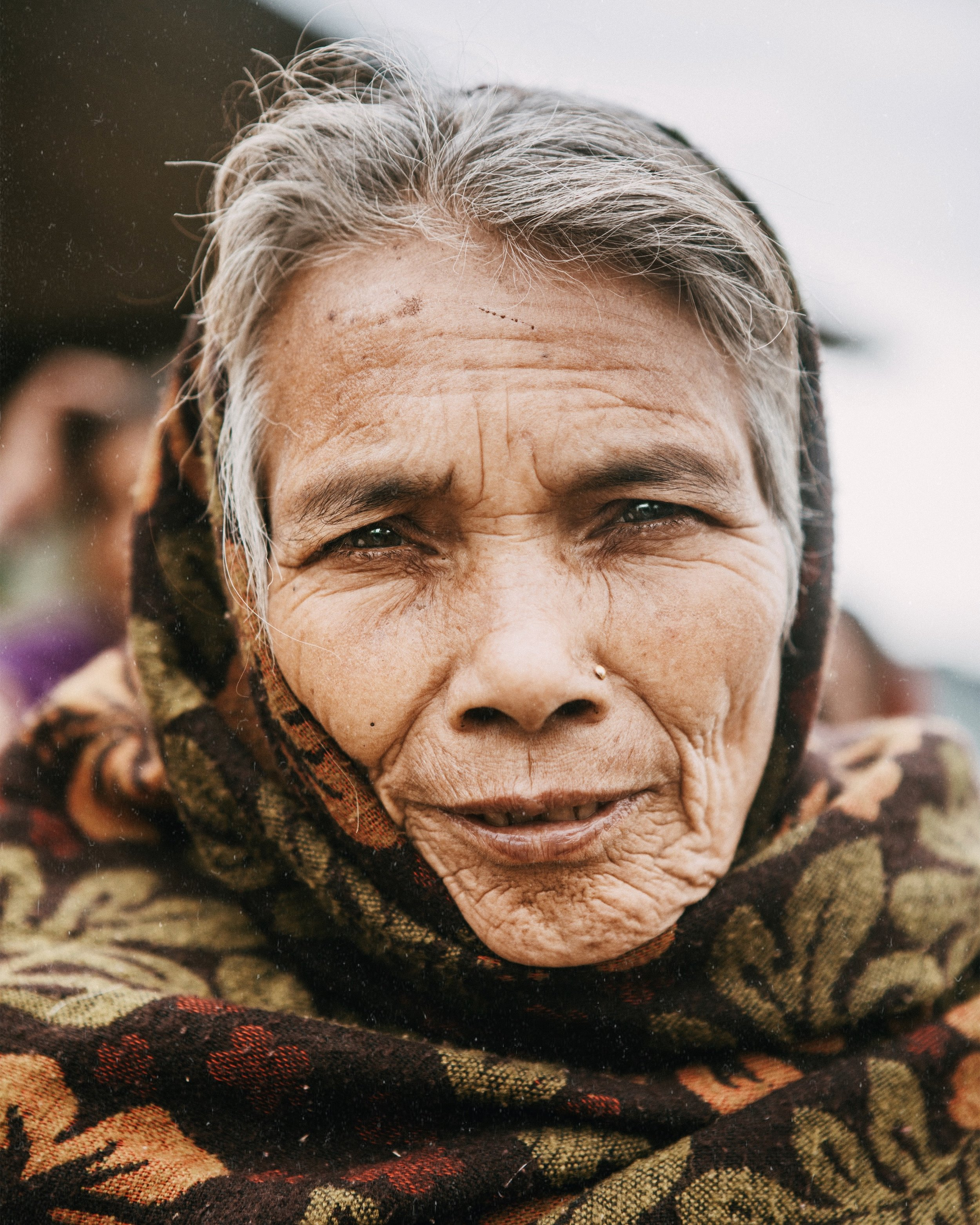 - A respected and wise woman in the village of Takure, Nepal is pleased when I ask to photograph her. The wrinkles in her face and the grays in her hair tell a million stories.