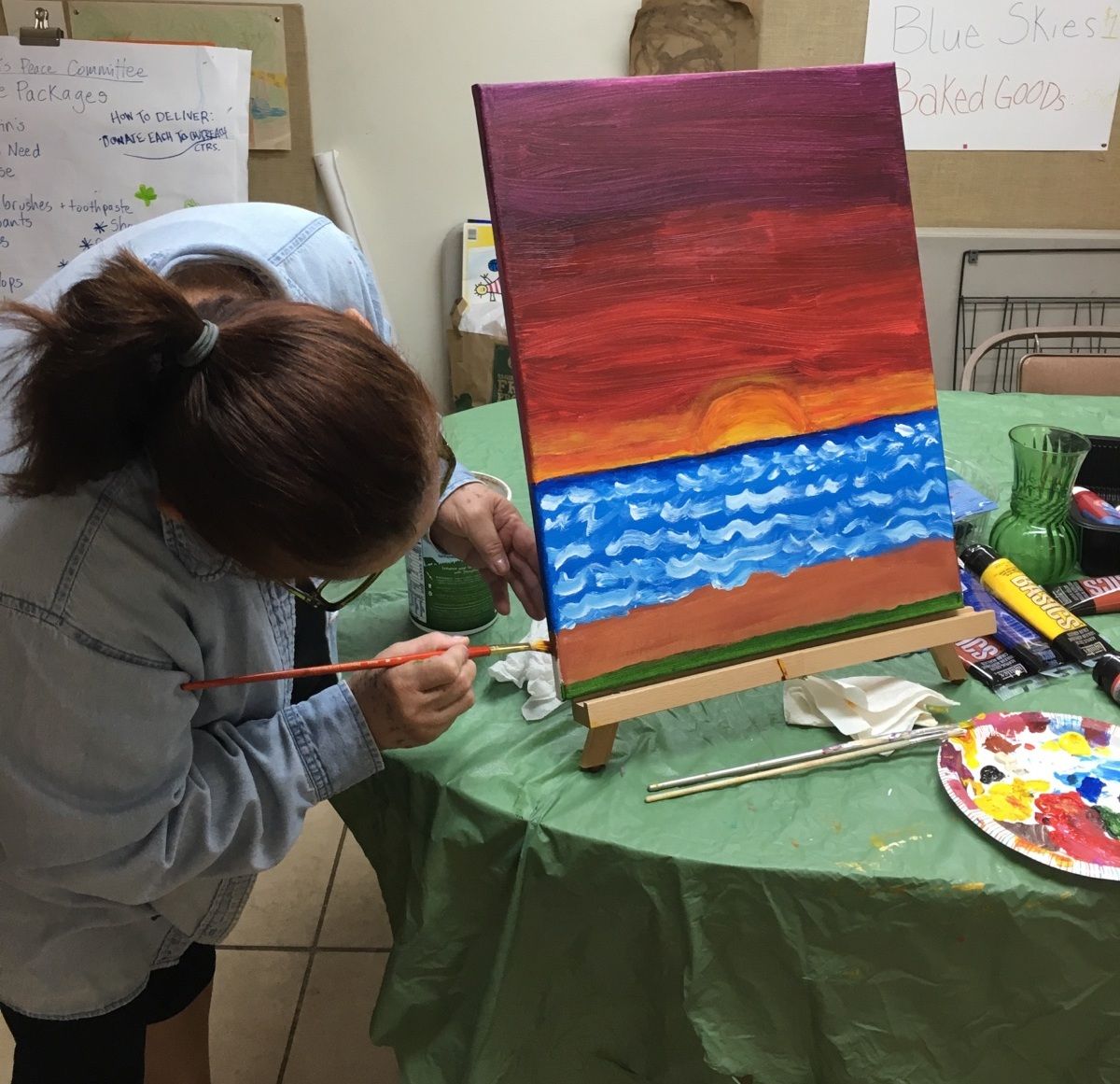 Emma at work on a painting.