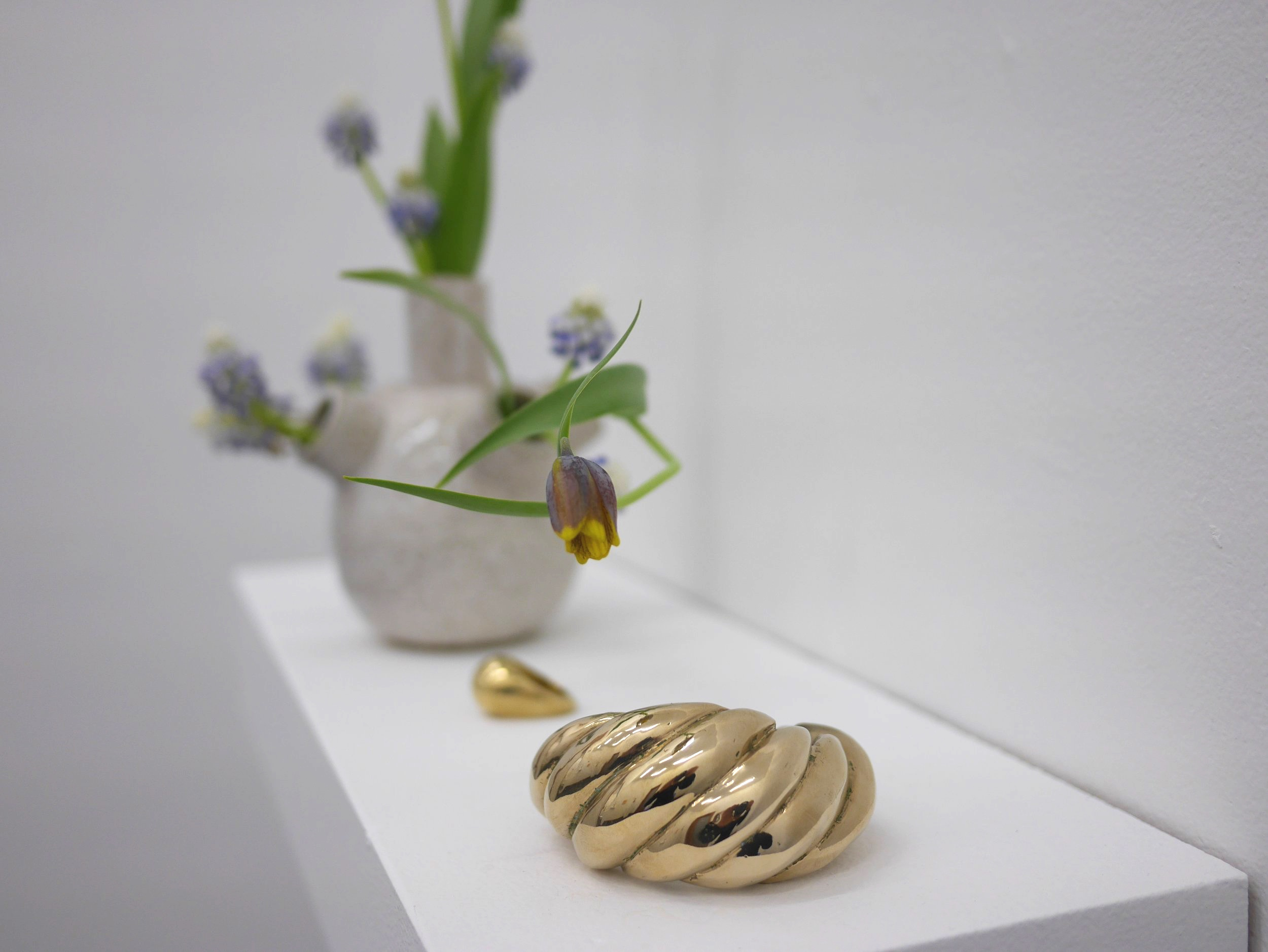 Flowers by Hilary Horvath  Vessel by Erica Prince  Jewelry by Laurel Hill
