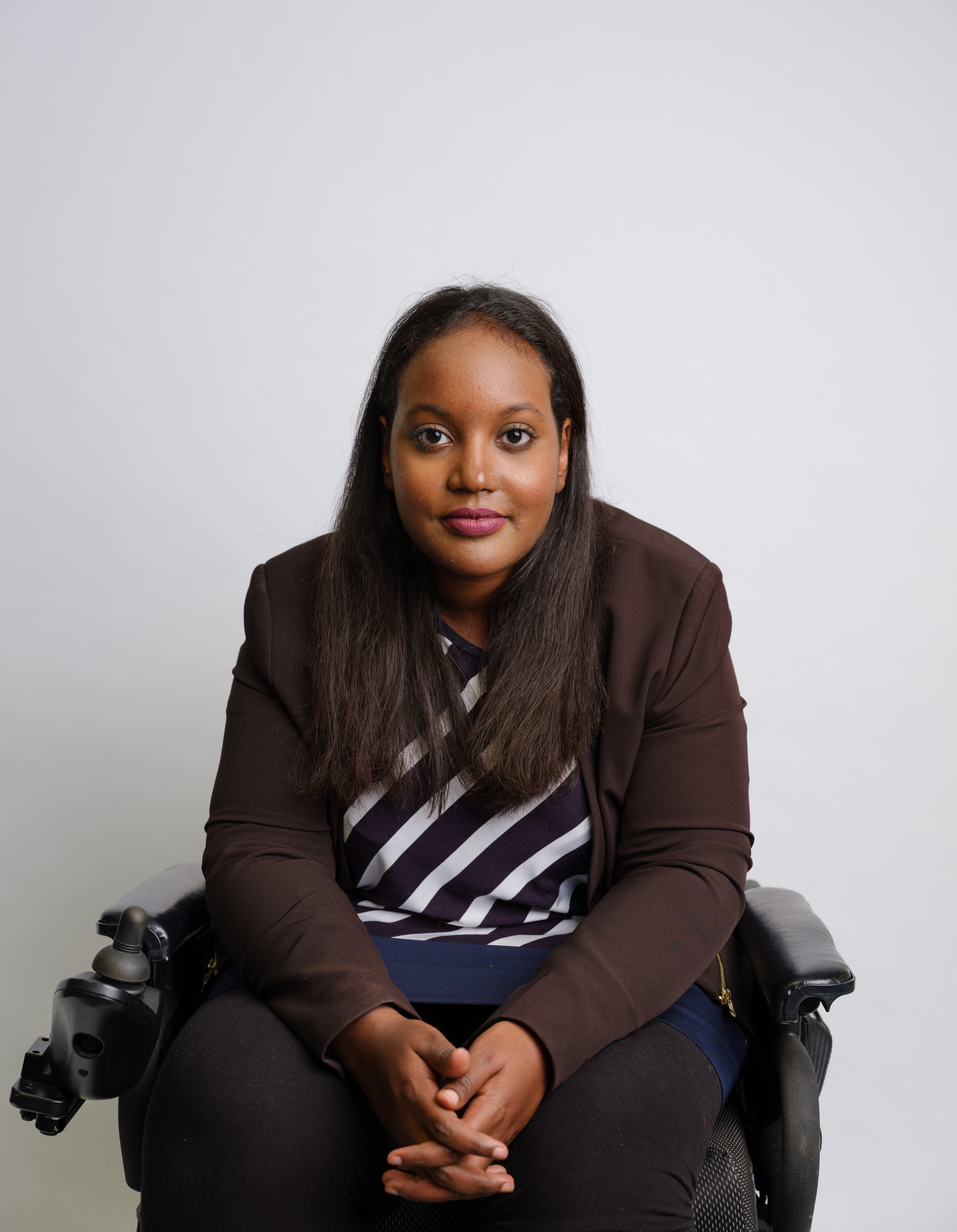 Portrait image of Sarah Jama sitting in a wheelchair and facing the camera.