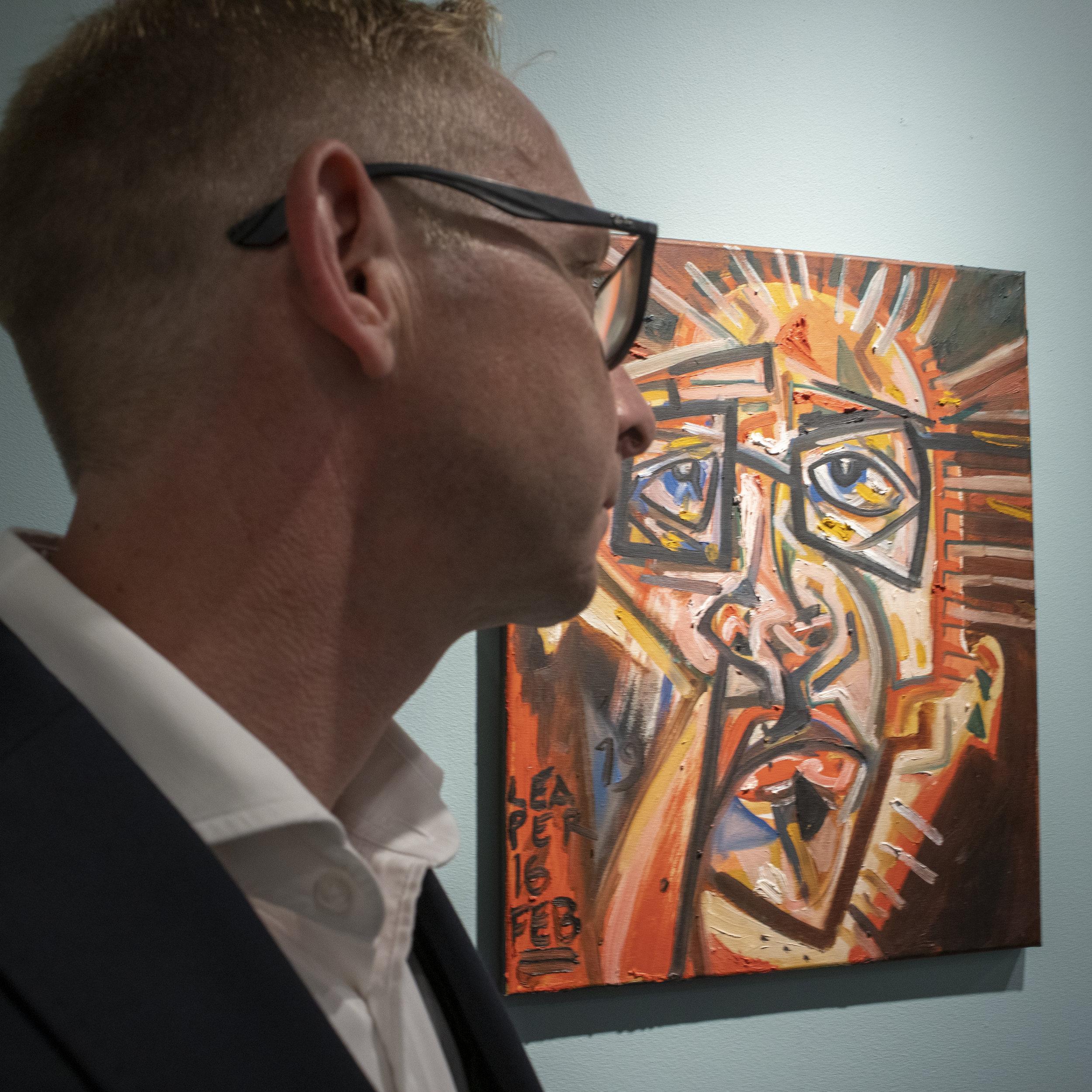 Mathew Leaper in front of  Self Portrait (after Miranda do Douro)   2019 Oil on canvas 49,5 x 40 x 2 cm