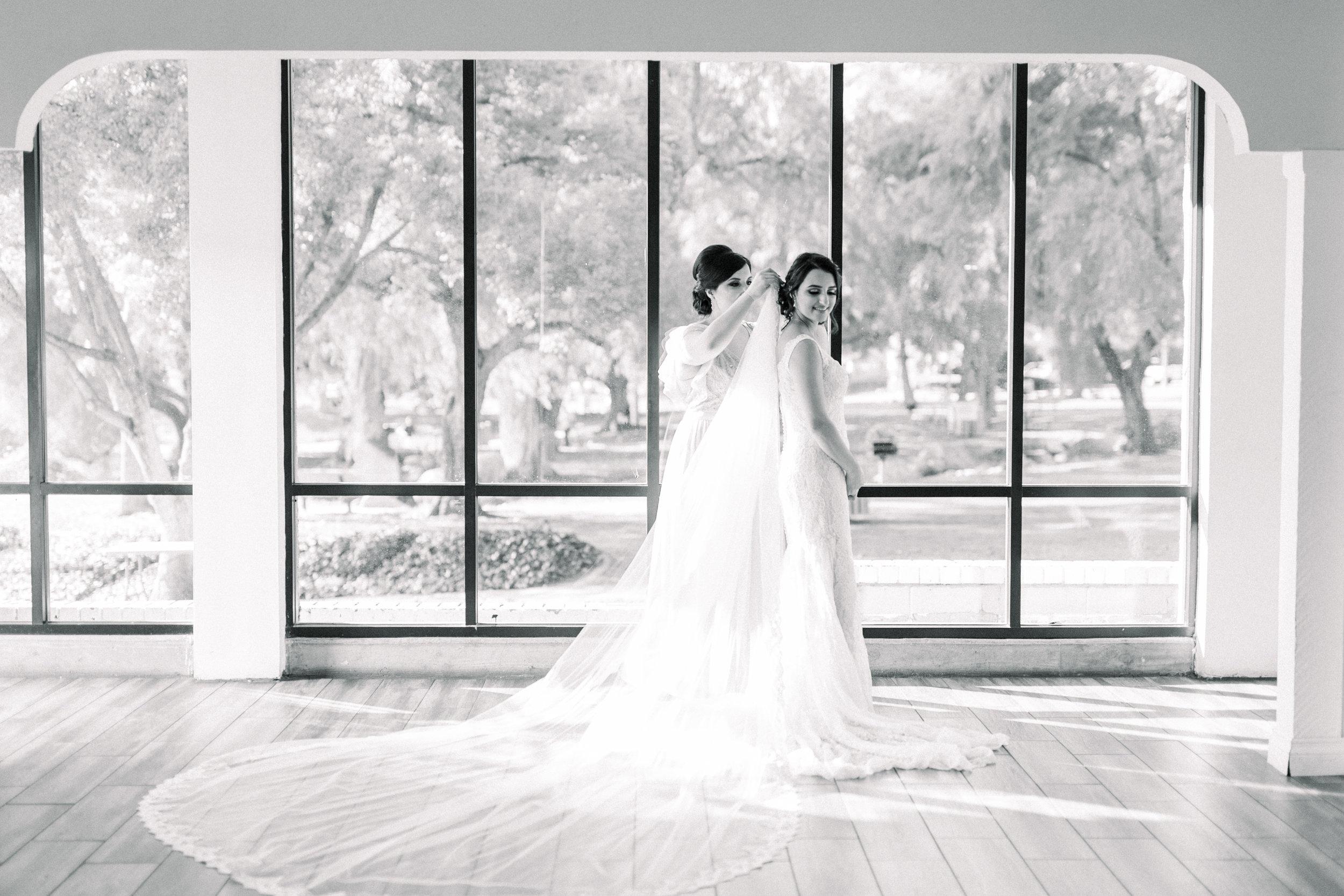 Bridal Portrait Putting on Veil