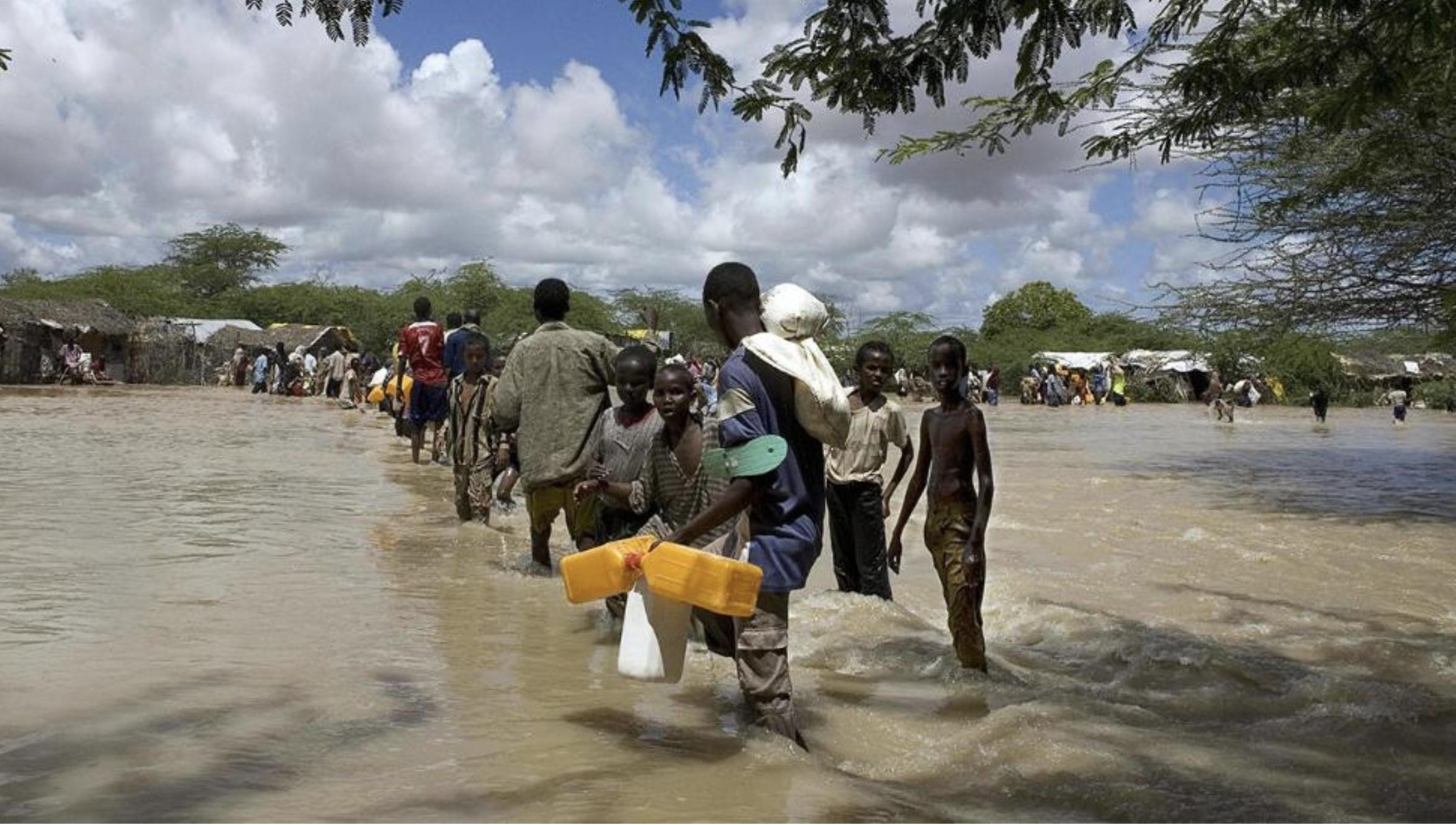 Somali refugees displaced by floods cross a swollen river in Dadaab, Garissa district in Kenya's arid northeastern province 22, November 2006.