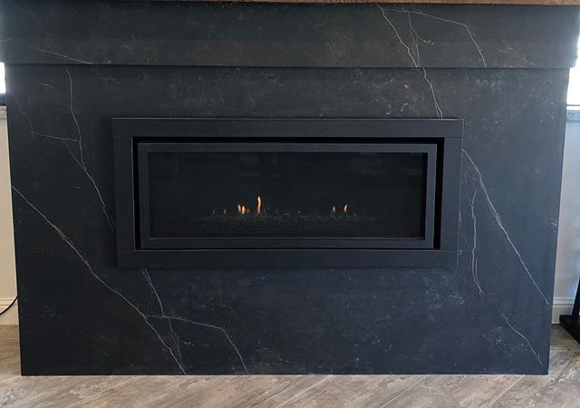 Looking to update your fireplace surround and don't know what to use-@dektonbycosentino is a great choice! It can withstand high heat. This color is called KELYA. #fireplace🔥#Dekton#stone#stonefabrication#sierrastoneinc#tuolumnecounty#sonoraca #twainharteca#jamestowncalifornia#shoplocal#remodel#porcelain#porcelainfireplace
